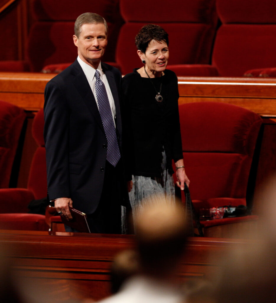 Elder David A. Bednar with his wife, Sister Susan Bednar, exit a session of general conference in October 2013.