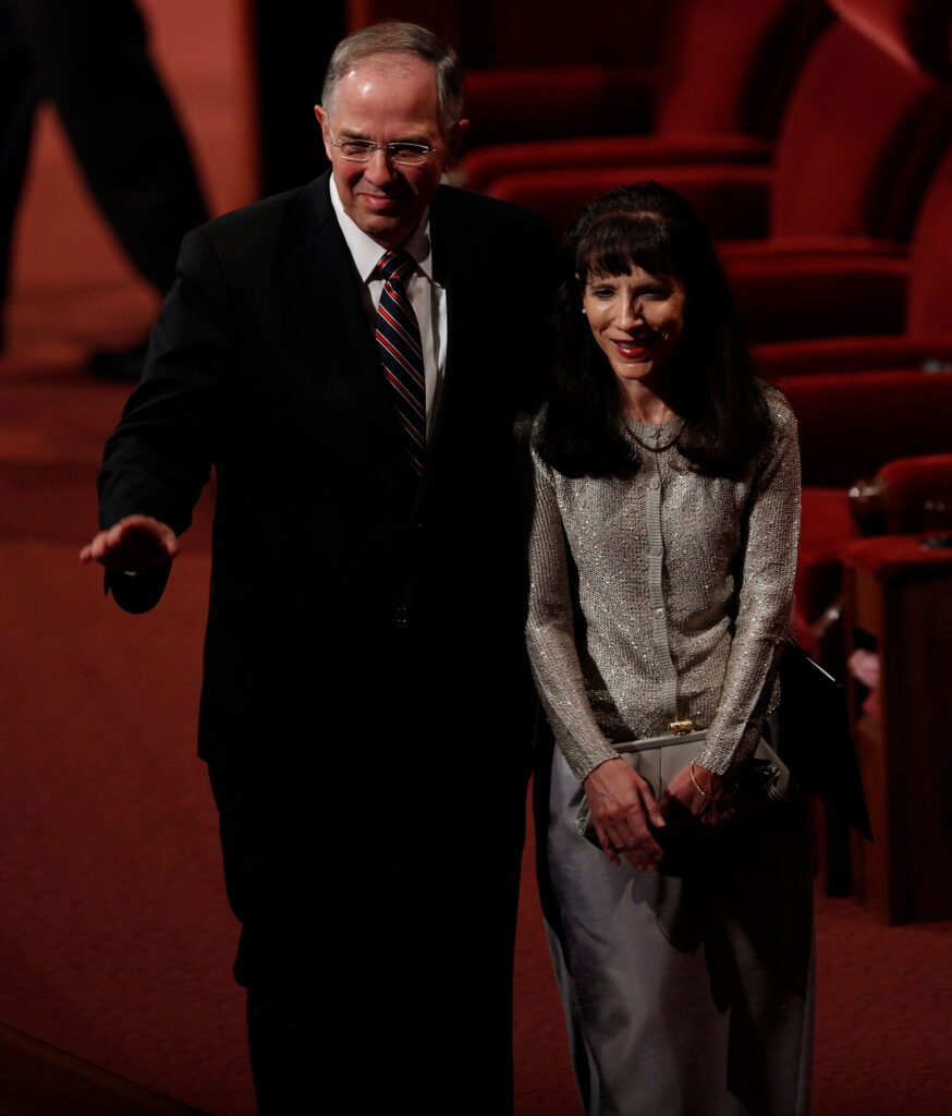 Elder Neil L. Andersen and his wife, Sister Kathy Andersen, exit a session of the 183rd semiannual general conference of the Church in October 2013.