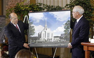 Elder William R. Walker, right, and Bishop Keith B. McMullin display a rendering depicting renovations planned for the Ogden Utah Temple.
