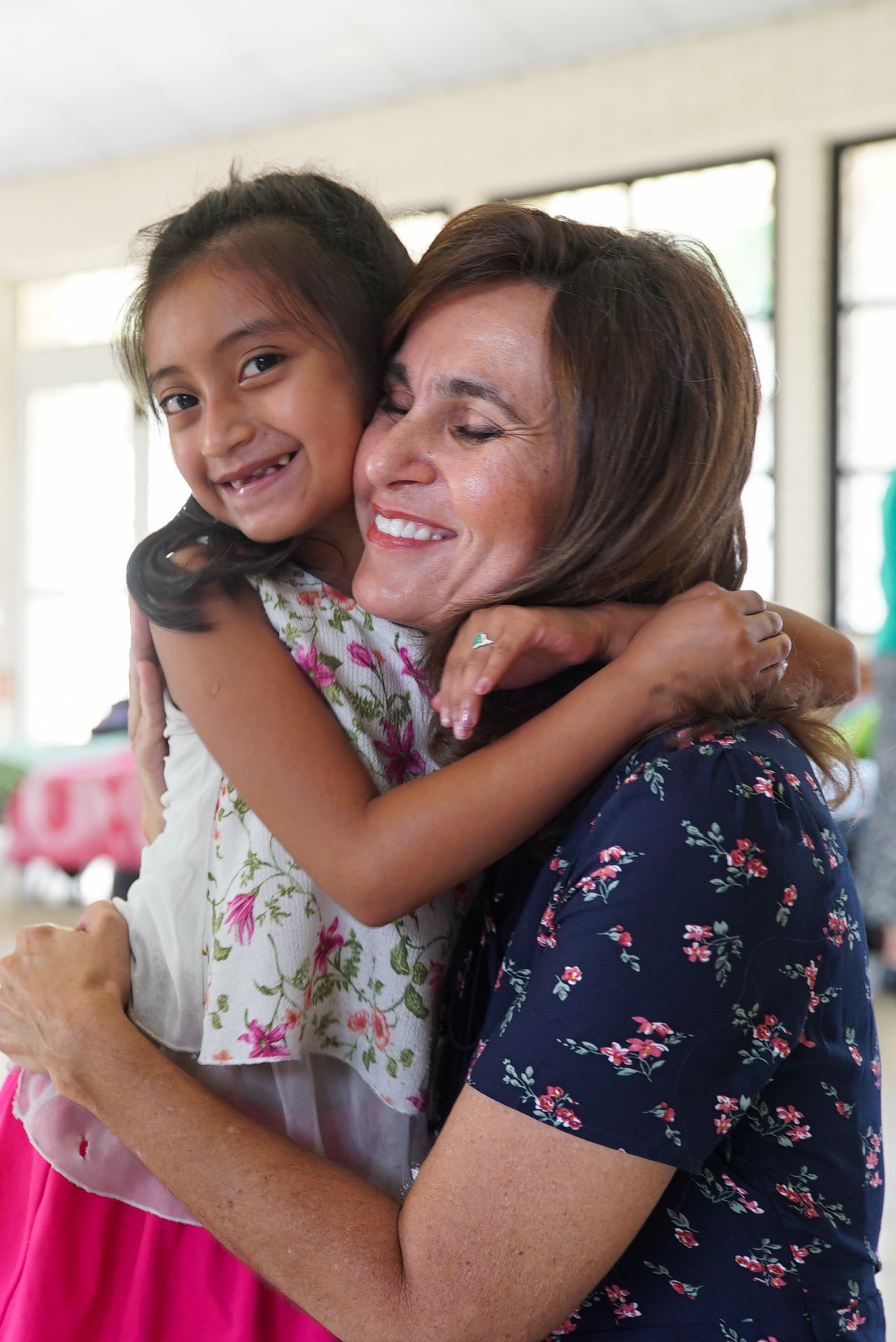 Sister Lisa L. Harkness, first counselor in the Primary general presidency, hugs a girl who is living in temporary housing in Escuintla, Guatemala, Wednesday, August 29, 2018.