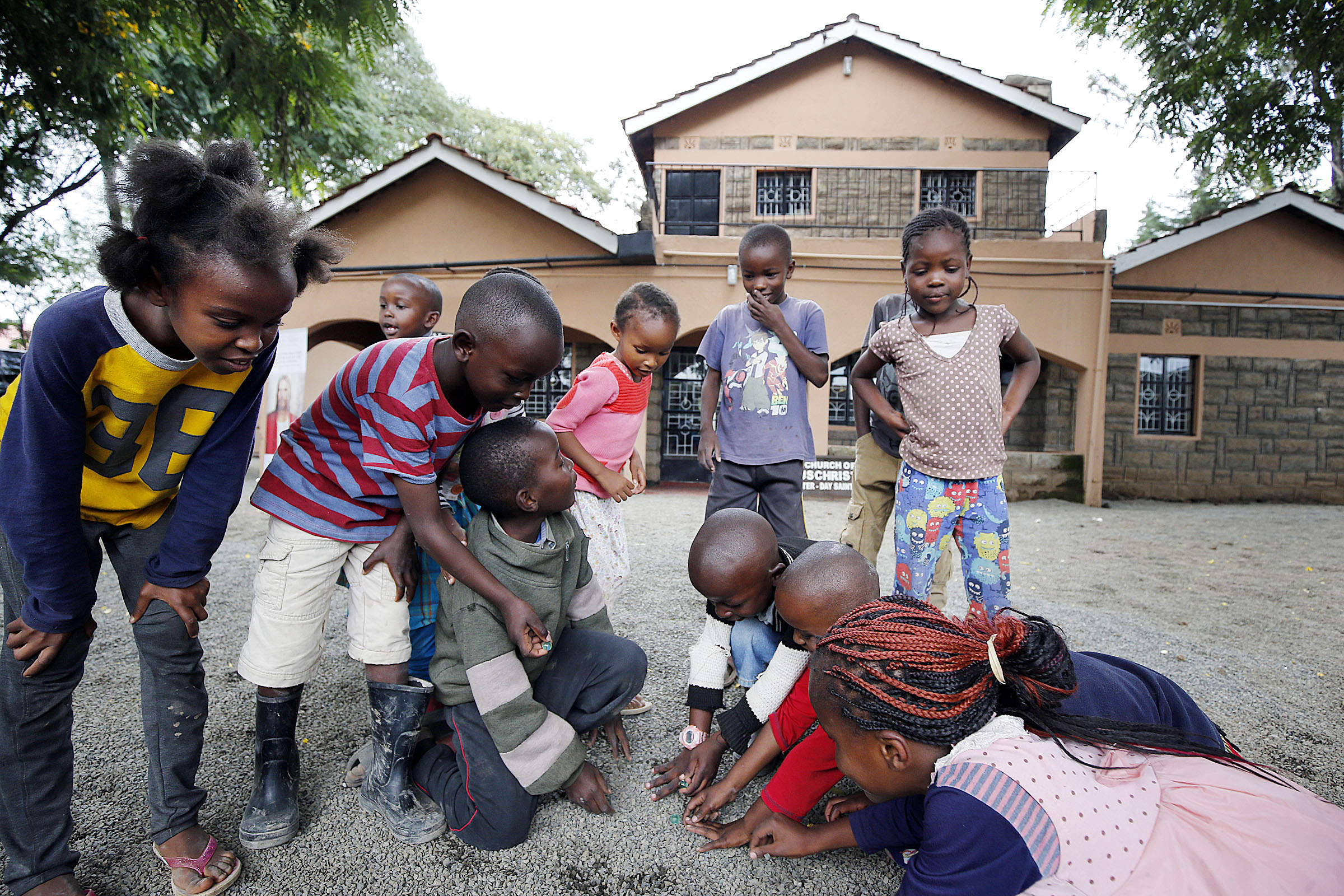 Kids play marbles at the Rongai meetinghouse on the outskirts of Nairobi, Kenya, on Saturday, April 14, 2018.