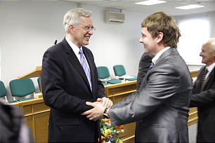 Elder Christofferson visits with members in Moscow, June 2012.