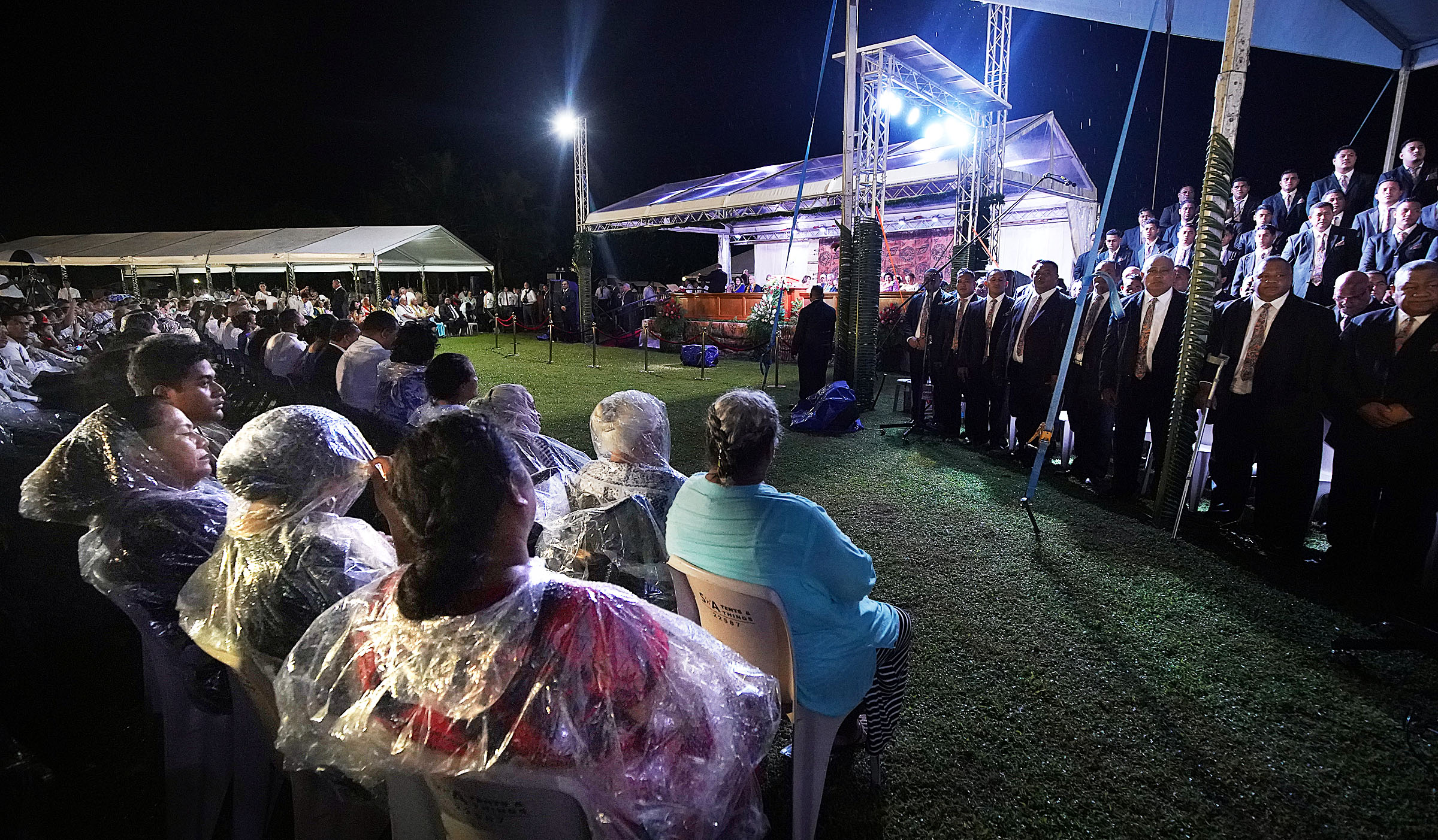 Many of those in attendance wear ponchos in the rain as the Apia Samoa Central Stake Choir sings during a devotional with President Russell M. Nelson of The Church of Jesus Christ of Latter-day Saints in Apia, Samoa, on Saturday, May 18, 2019.