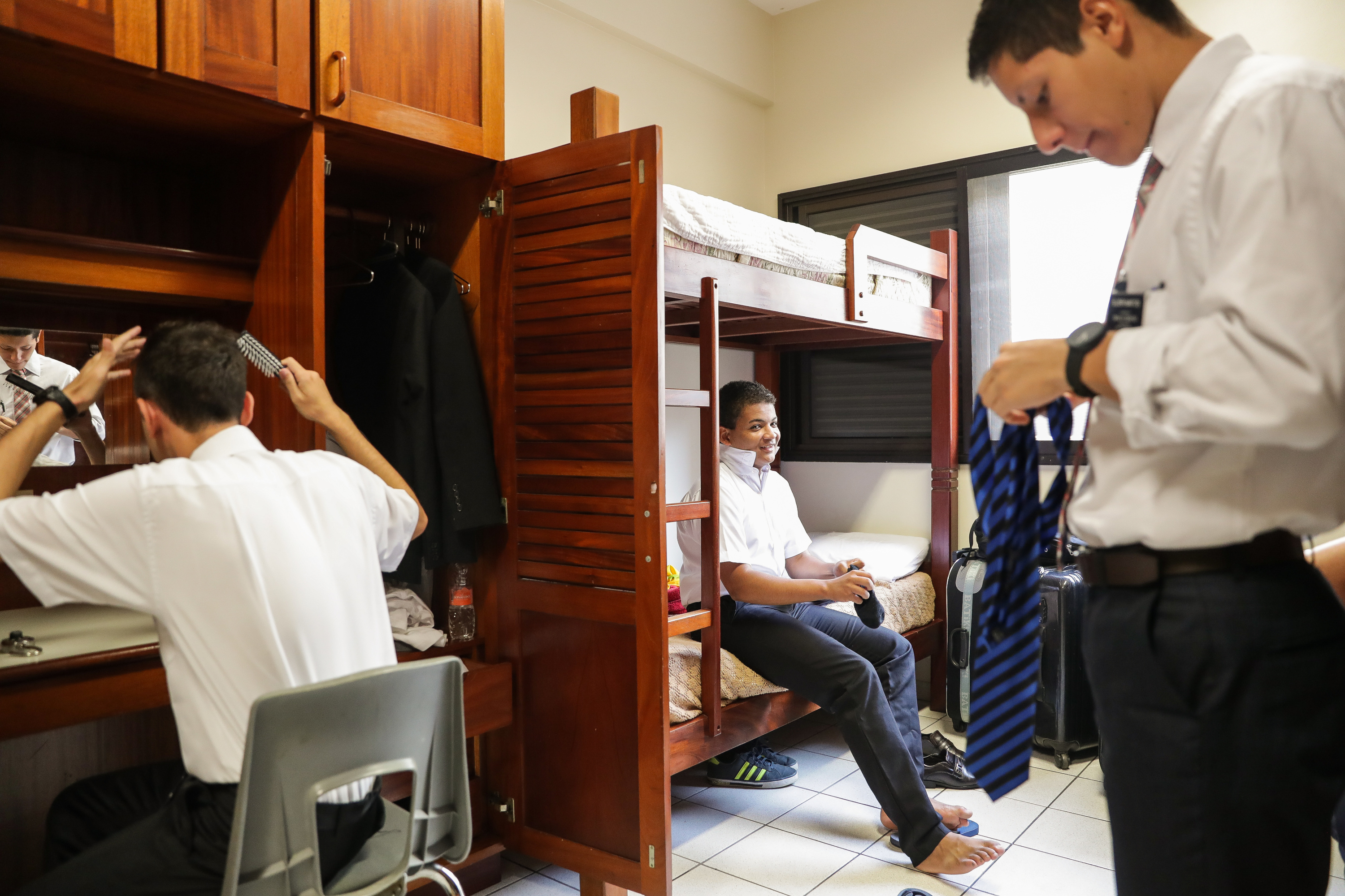 Elder Nefi Moraes, Elder Carlos Bastos and Elder Wesley Santos get dressed in their residence room at the Brazil Missionary Training Center in Sao Paulo on Thursday, May 24, 2018.