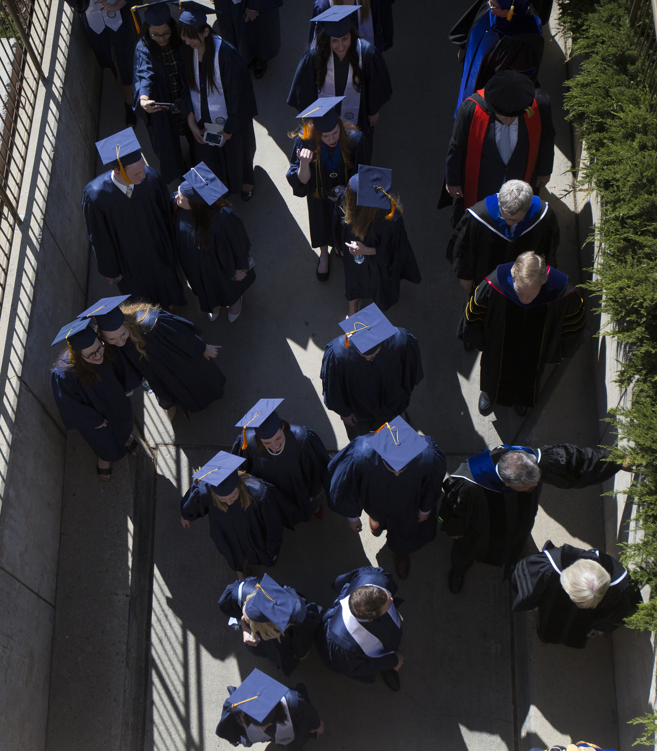 Graduates file into the Marriott Center prior to the start of Brigham Young University's commencement ceremony on Thursday, April 26, 2018, in Provo. BYU is awarding nearly 6,300 degrees to graduates this week.