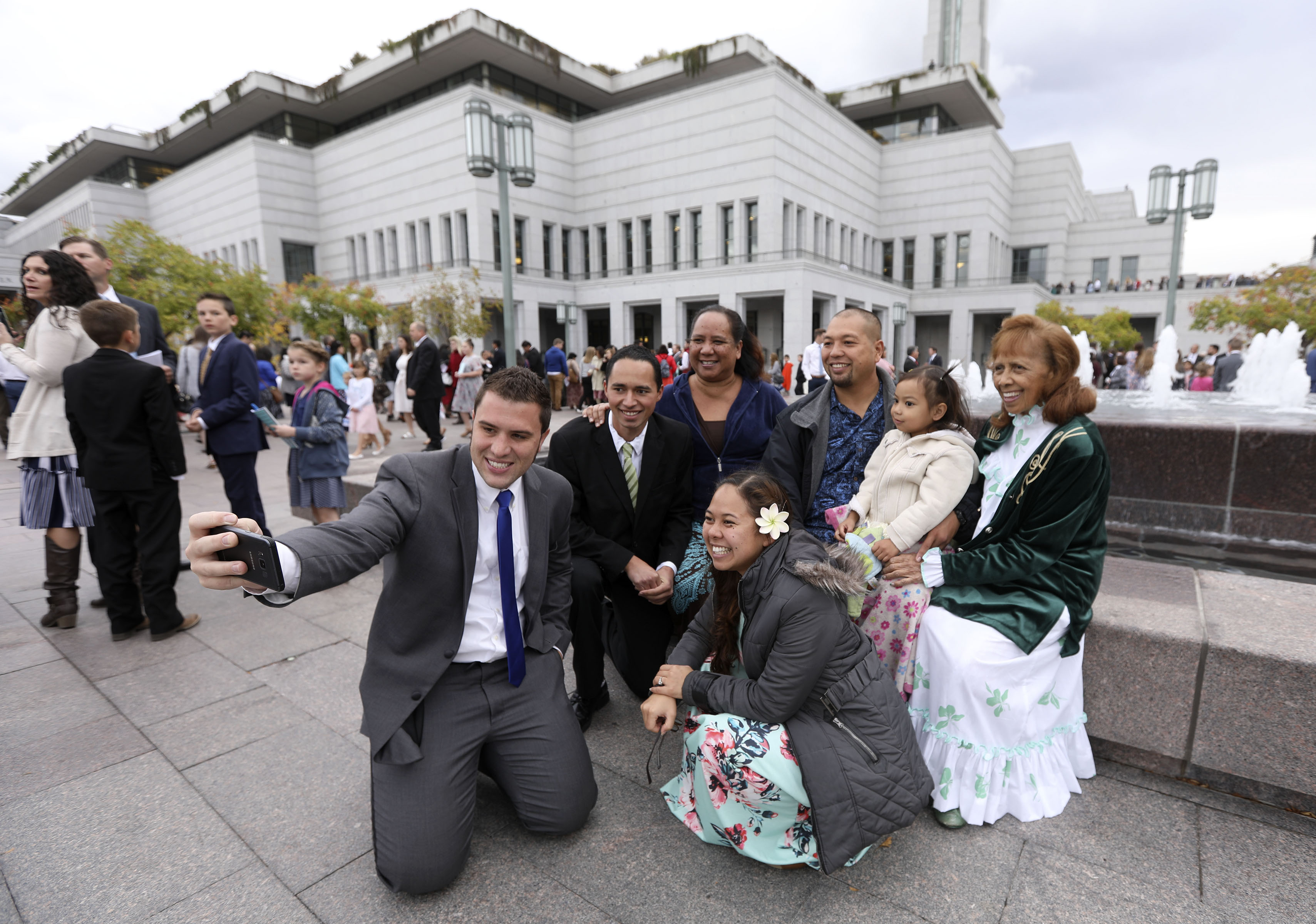 Tyler Bond takes a selfie with family members before the Sunday morning session of the 188th Semiannual General Conference of The Church of Jesus Christ of Latter-day Saints outside of the Conference Center in downtown Salt Lake City on Sunday, Oct. 7, 2018.