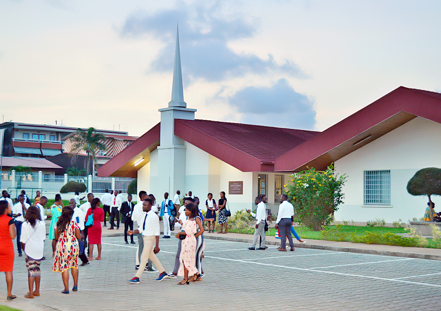 Church members stand outside the meetinghouse in Abidjan, Cote D'Ivoire. Elder Neil L. Andersen and Elder Ulisses Soares traveled throughout the Africa West Area from May 19-28, 2018.