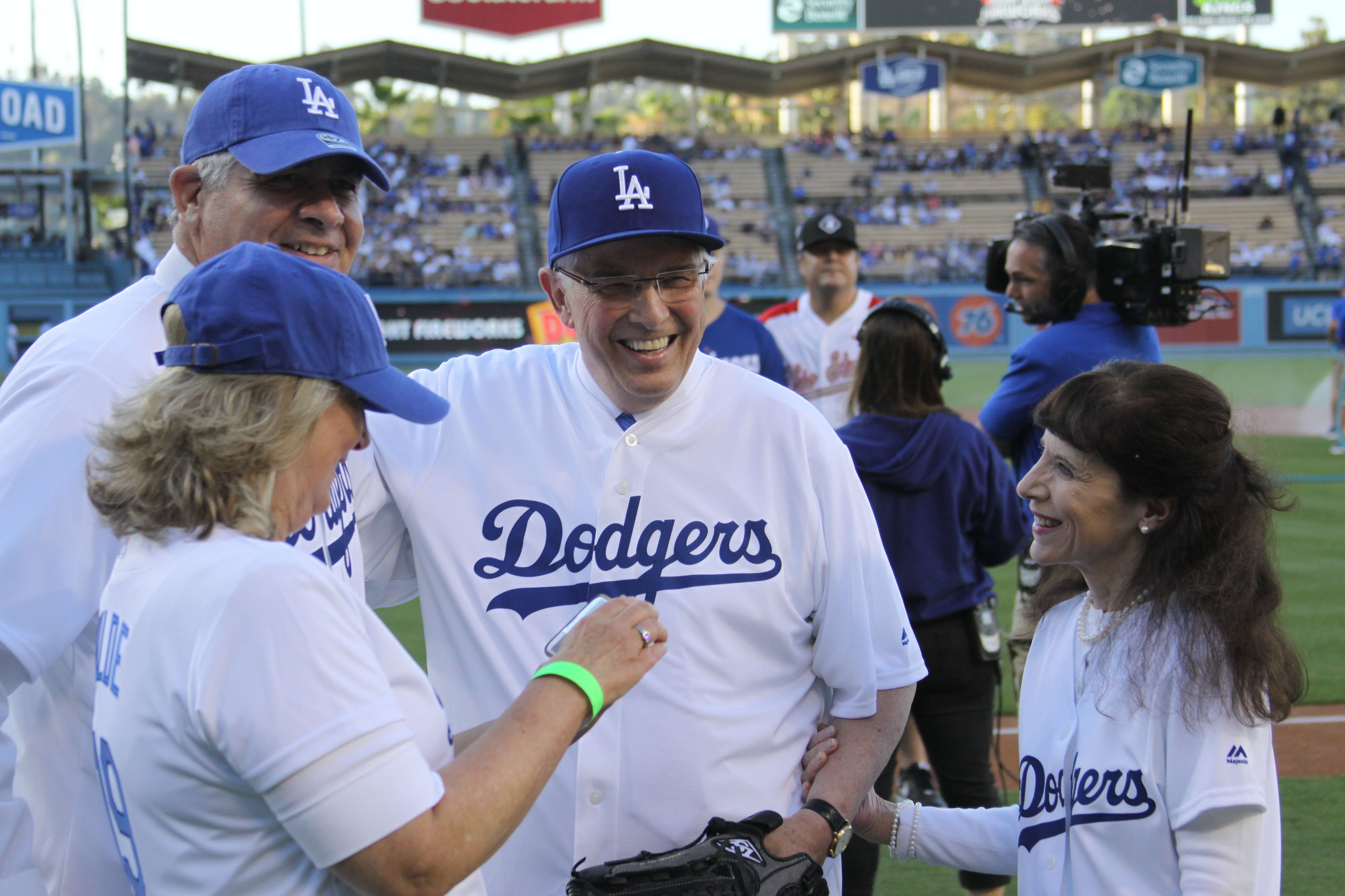 Elder Neil L. Andersen and his wife, Sister Kathy Andersen, greet Sister Cheryl Wilde and Elder Gary Wilde, an Area Seventy, after Elder Andersen threw the first pitch at Dodger Stadium on July 19, 2019.