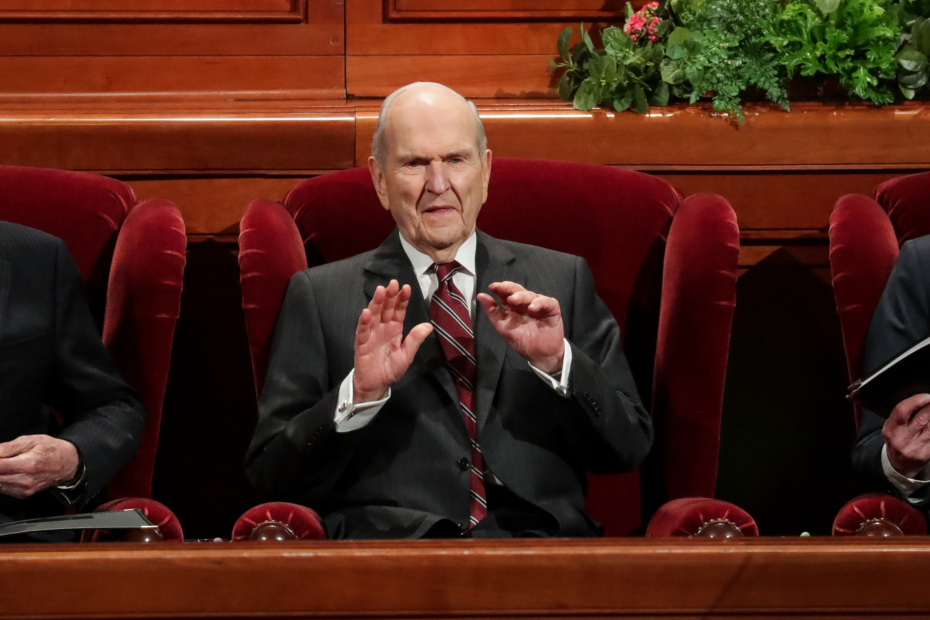 President Russell M. Nelson, center, waves as he and President Dallin H. Oaks, first counselor, left, and President Henry B. Eyring, second counselor, right, take their seats for the Saturday afternoon session of the 188th Semiannual General Conference of The Church of Jesus Christ of Latter-day Saints in the Conference Center in Salt Lake City on Saturday, Oct. 6, 2018.