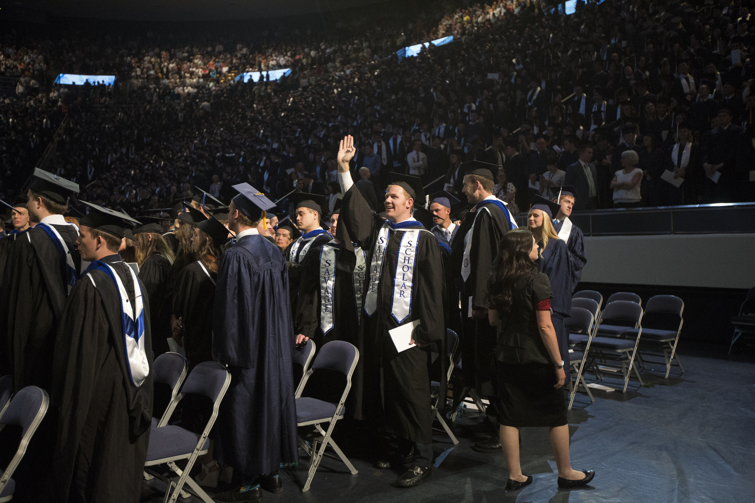 BYU graduate Josh Tidwell, of San Diego, California, waves to family as graduates make their way out of the Marriott Center during Brigham Young University's commencement ceremony Thursday, April 26, 2018, in Provo. BYU is awarding nearly 6,300 degrees to graduates this week.