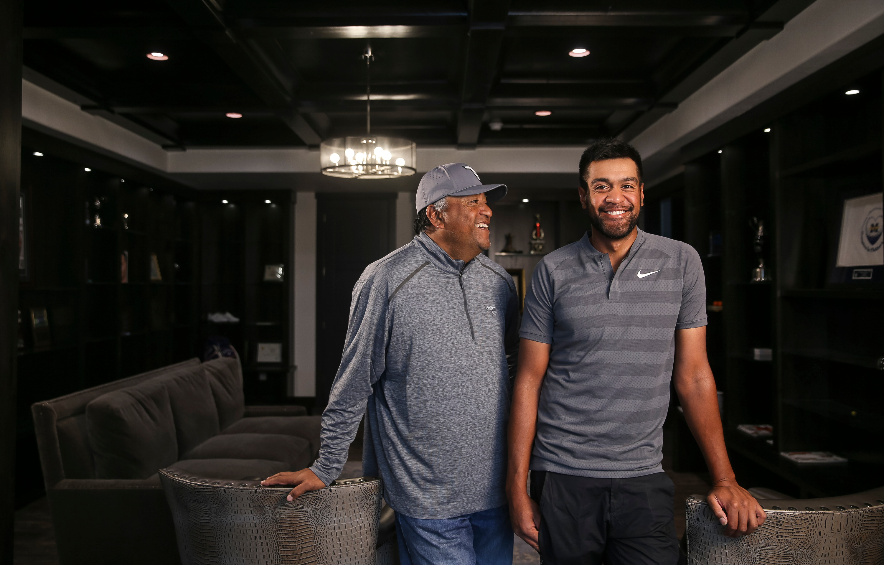 PGA golfer Tony Finau, right, and his father, Kelepi Finau, pose for a photo at Tony's home in Lehi on Tuesday, Feb. 6, 2018.