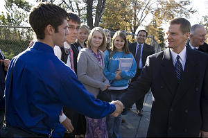 Elder David A. Bednar of Quorum of the Twelve, right, greets students at BYU-Idaho, where he presided during its transition from Ricks College.