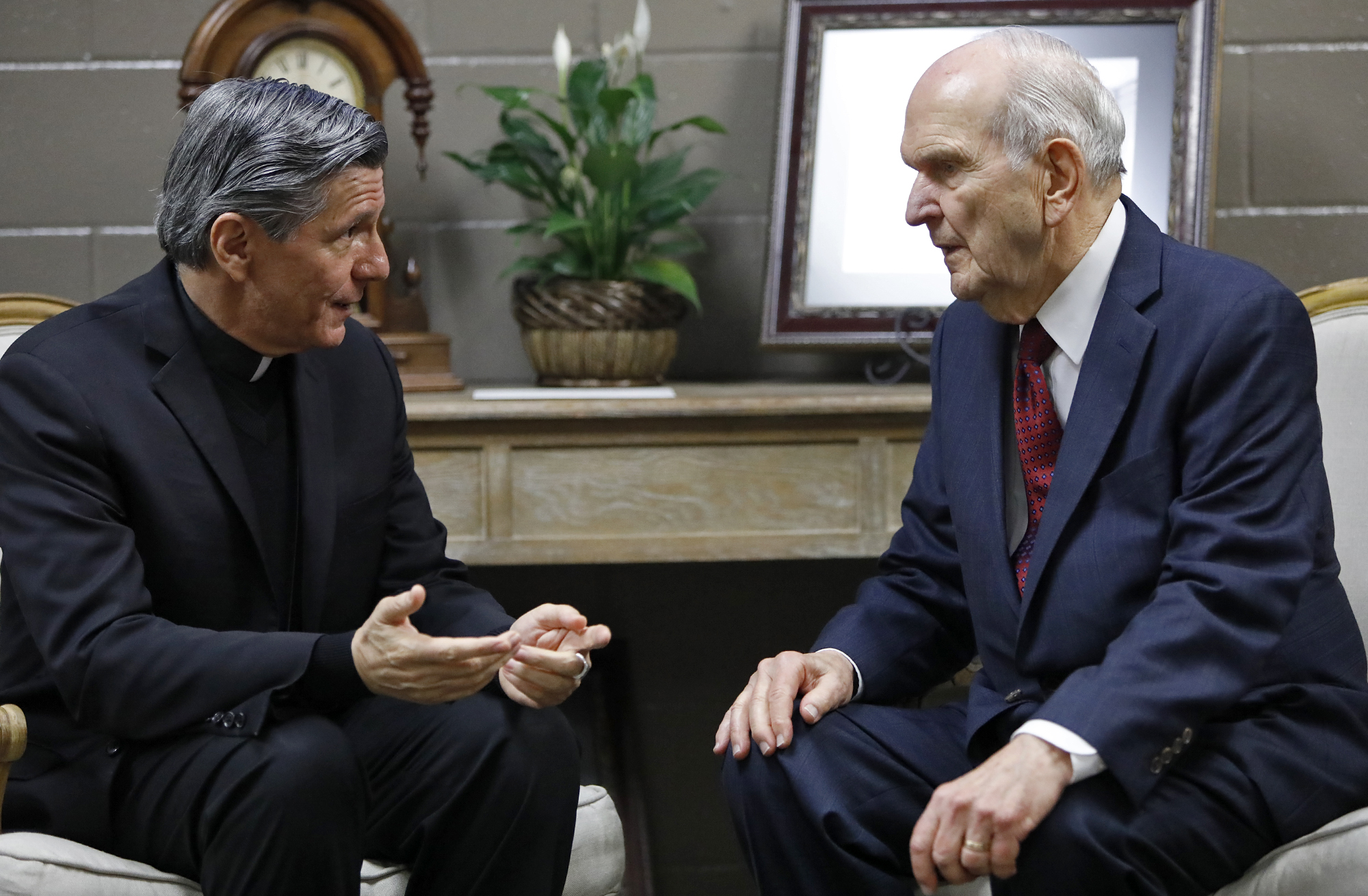 Archbishop of San Antonio Gustavo Garcia-Siller (left) speaks with President Russell M. Nelson of The Church of Jesus Christ of Latter-day Saints before the devotional held Sunday, Nov. 18, 2018, at the Alamodome in San Antonio, TX.