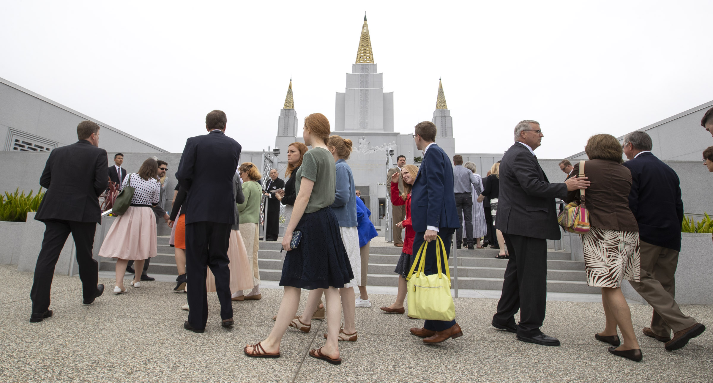 Latter-day Saints enter the Oakland California Temple to hear President Dallin H. Oaks, first counselor in the First Presidency, rededicate the building on Sunday, June 16, 2019.