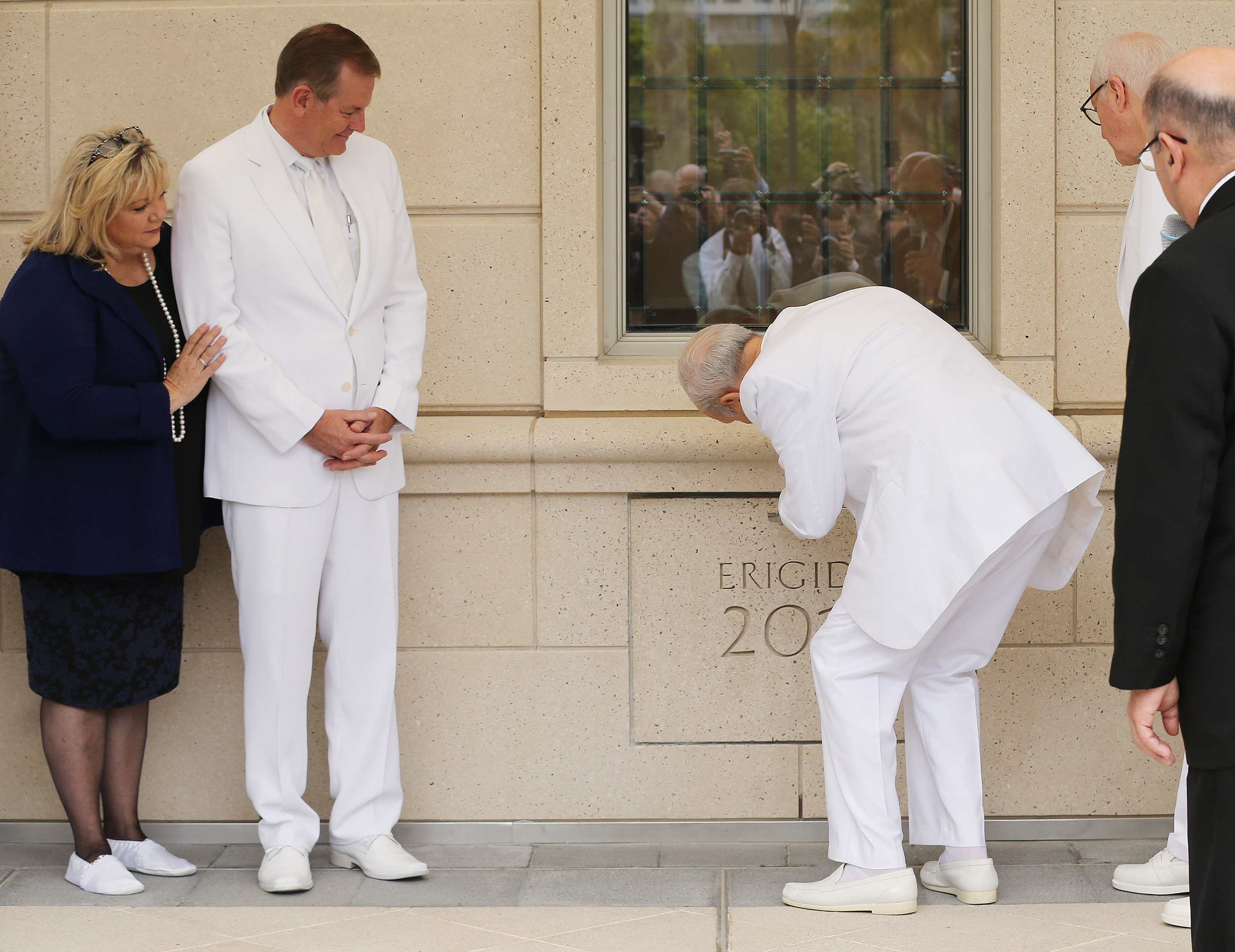 Elder Gary E. Stevenson of the Quorum of the Twelve Apostles and his wife, Sister Lesa Stevenson, watch as President Russell M. Nelson places mortar in the corner stone during the dedication of the Concepcion Chile Temple in Concepcion, Chile, on Sunday, Oct. 28, 2018.
