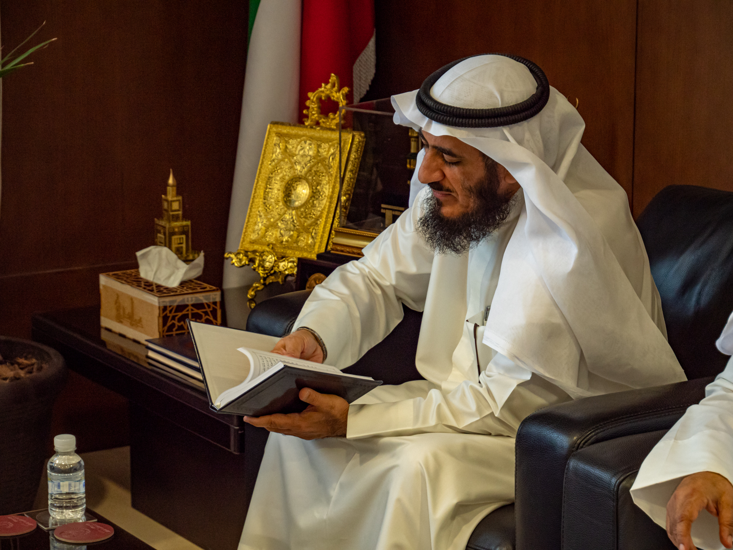 Mr. Fareed Emadi, secretary general of the Supreme Commission for the Promotion of Moderation in the Ministry of Awqaf, leafs through a Book of Mormon given to him by Elder Quentin L. Cook in Kuwait City on June 10, 2019.