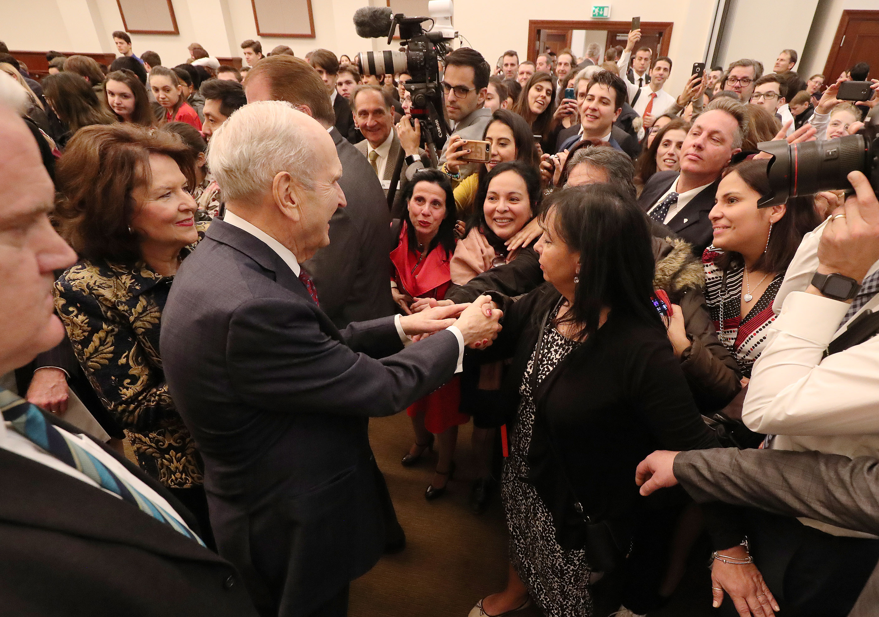 President Russell M. Nelson of The Church of Jesus Christ of Latter-day Saints and his wife, Sister Wendy Nelson, greet attendees after a youth devotional in Rome, Italy, on Saturday, March 9, 2019.