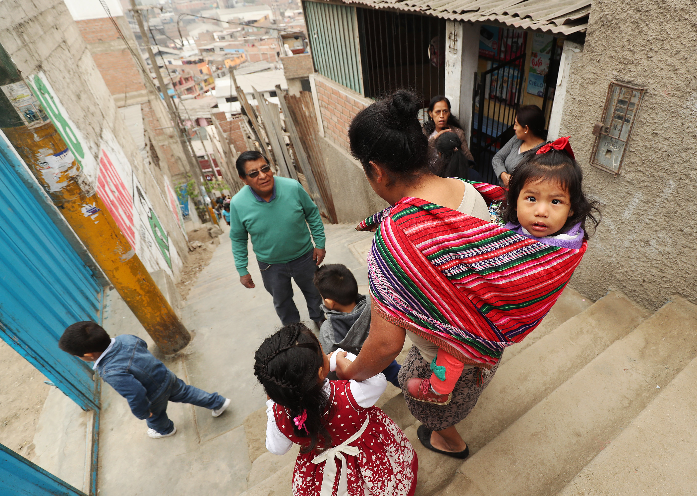Valentine Alfredo walks with her daughters to the Heart of Jesus Preschool in Lima, Peru, on Friday, Oct. 19, 2018. LDS Charities donated three prefab classrooms, including tables and chairs and other school supplies.