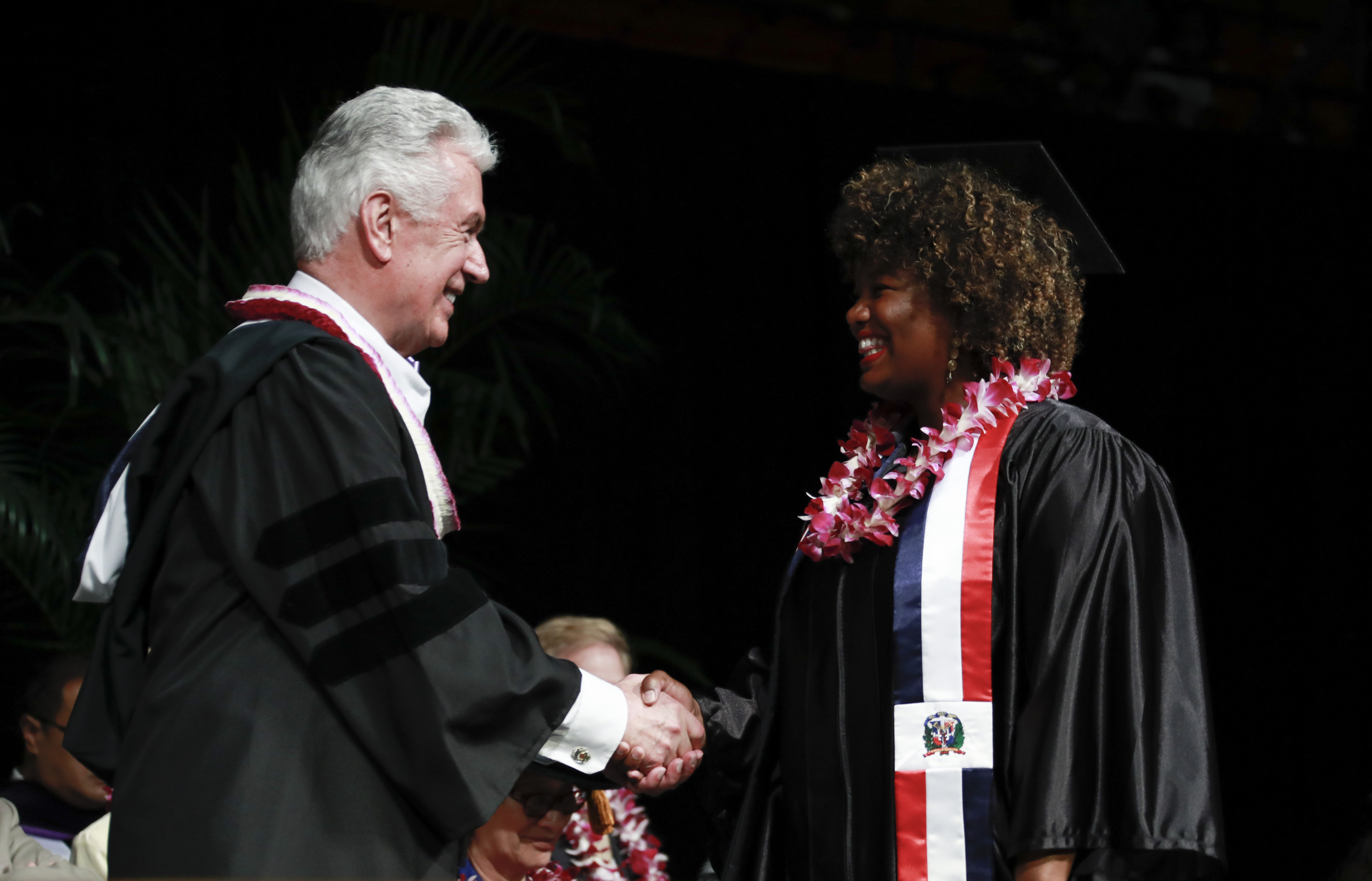 Elder Dieter F. Uchtdorf of the Quorum of the Twelve Apostles greets a BYU-Hawaii graduate during commencement on Dec. 14.