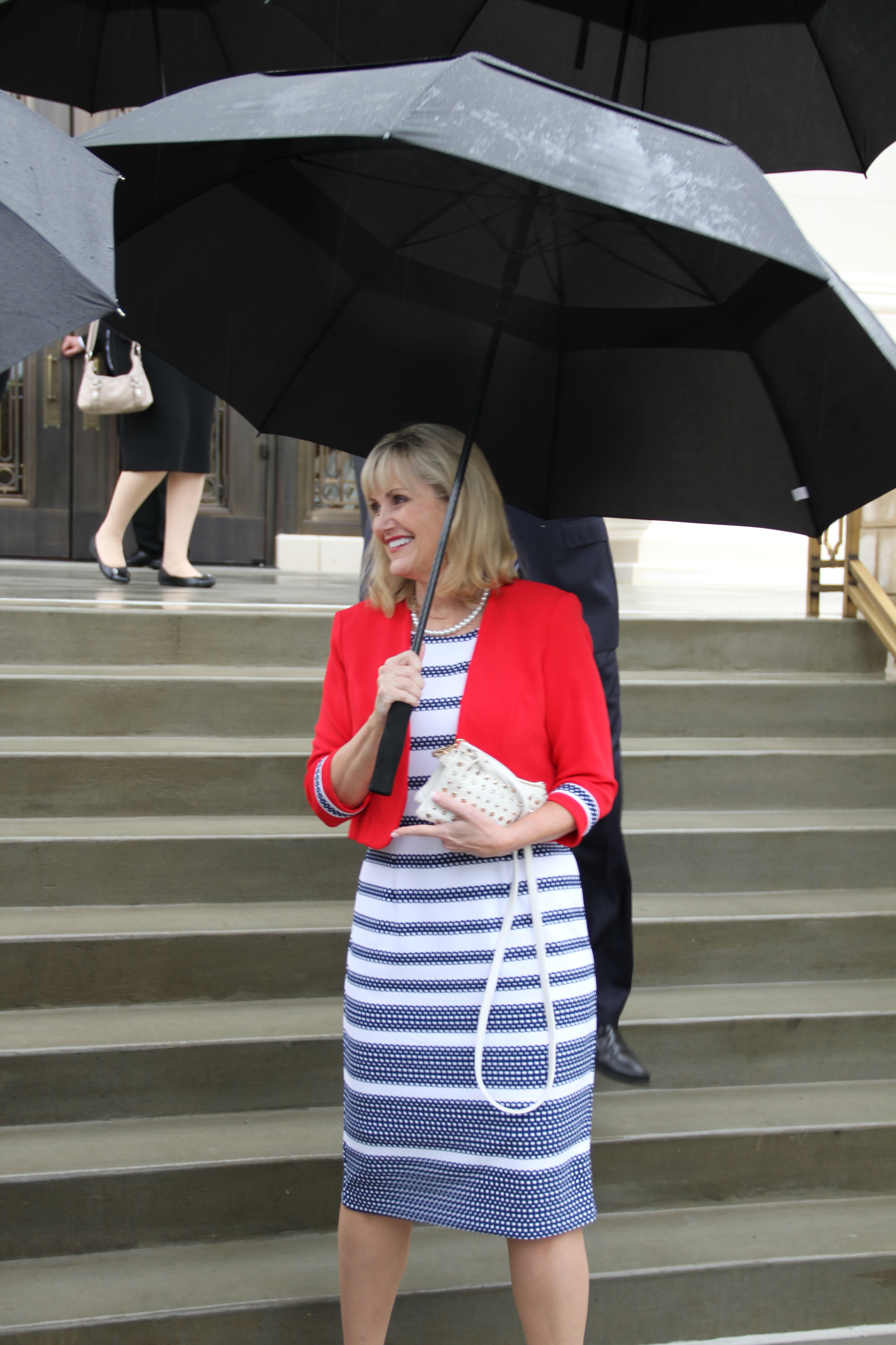 Sister Karen Beheshti exits the Memphis Tennessee Temple to rainy day in Memphis on May 4 after touring through the newly renovated temple.