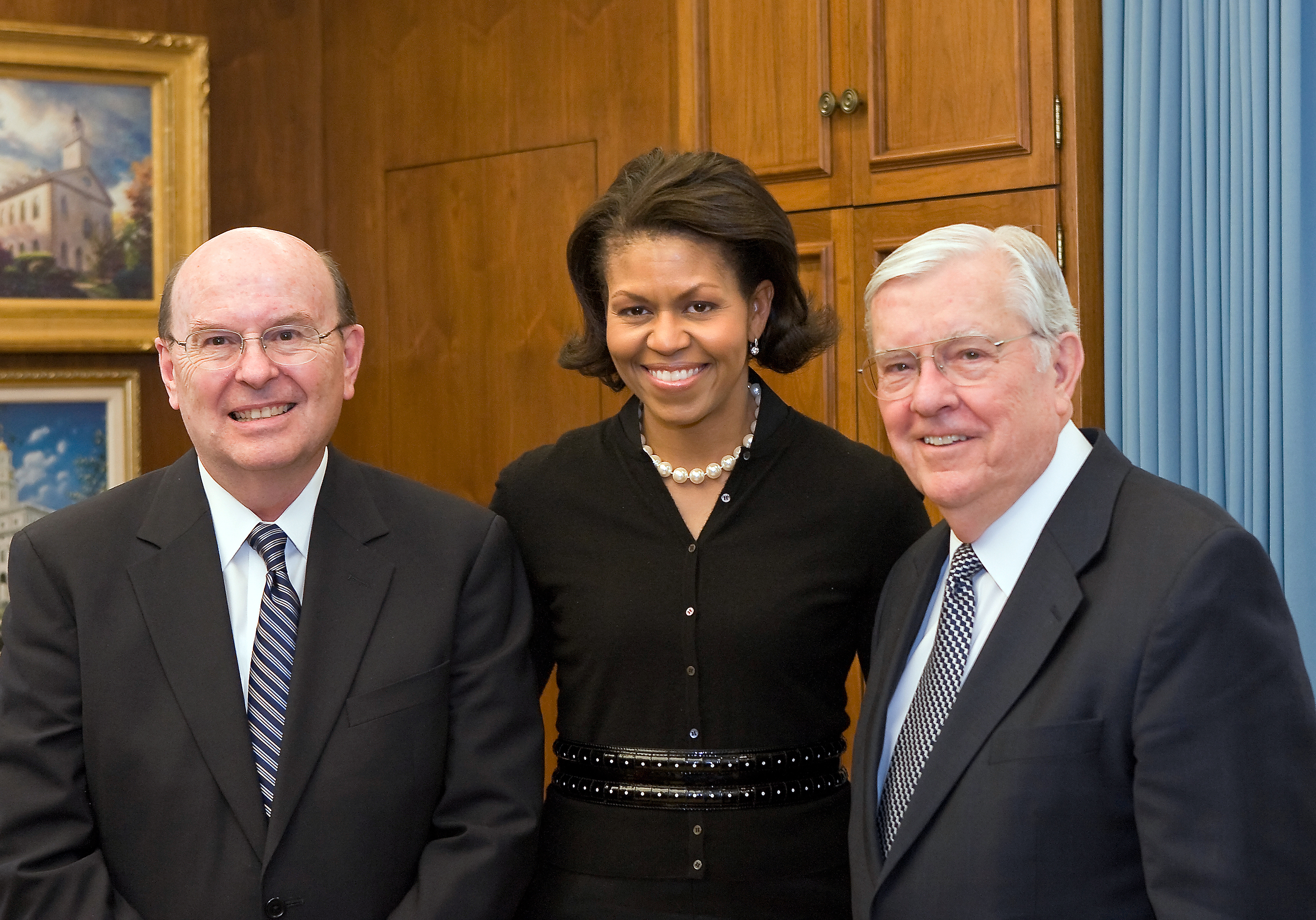 From left, Elder Quentin L. Cook, Michelle Obama and Elder M. Russell Ballard, are photographed as the former First Lady visits Church headquarters in February 2008.