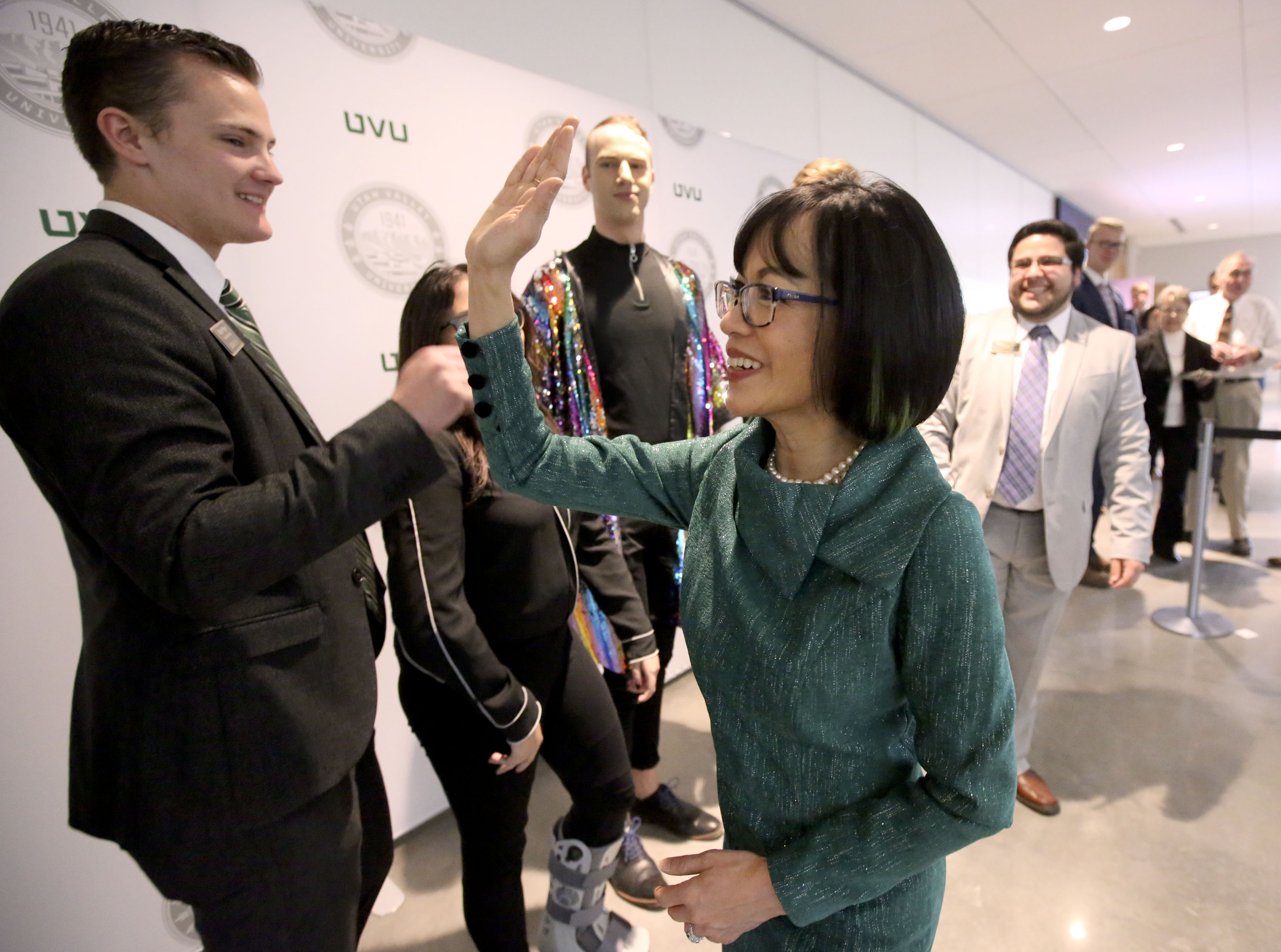 Astrid S. Tuminez, Utah Valley University's seventh president, waits for a high-five after her inauguration ceremony at the UVU Noorda Center for the Performing Arts in Orem, Utah, on March 27, 2019.