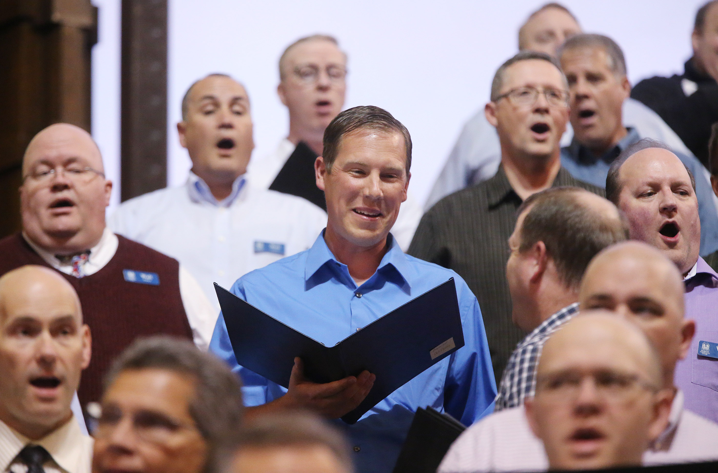 Daniel Wilson, center, sings with The Tabernacle Choir at Temple Square during a rehearsal in Salt Lake City on Thursday, April 11, 2019. Four people were selected through social media to sing with the choir.