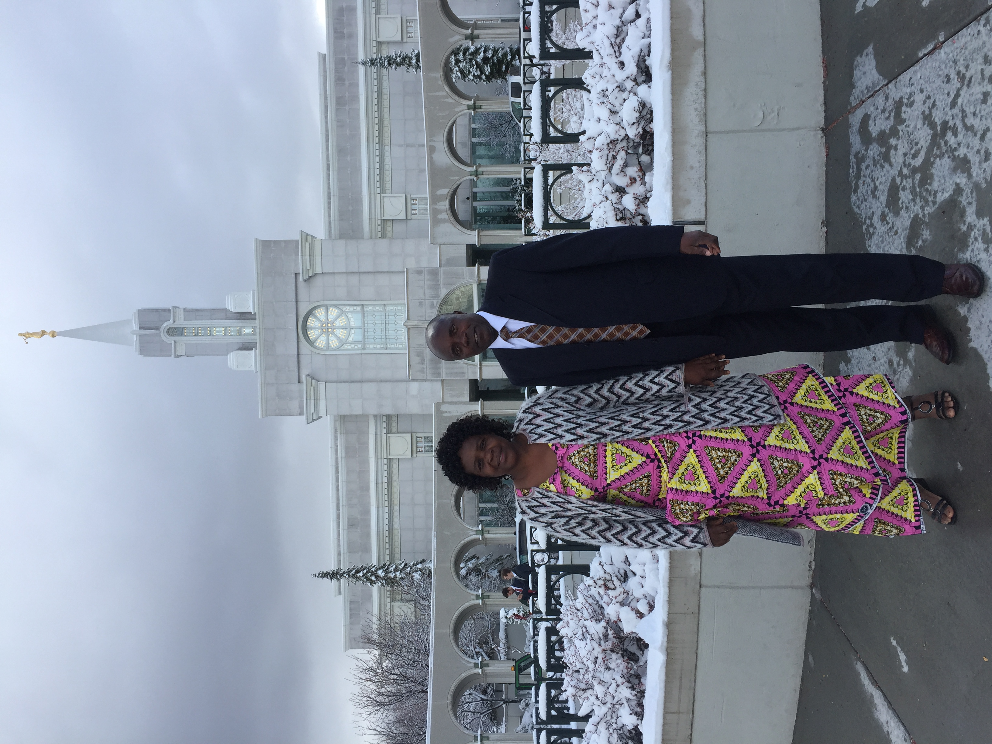 Donatira Kabaji and Mitonzi Bakunz stand in front of the Bountiful Utah Temple after receiving their endowments.