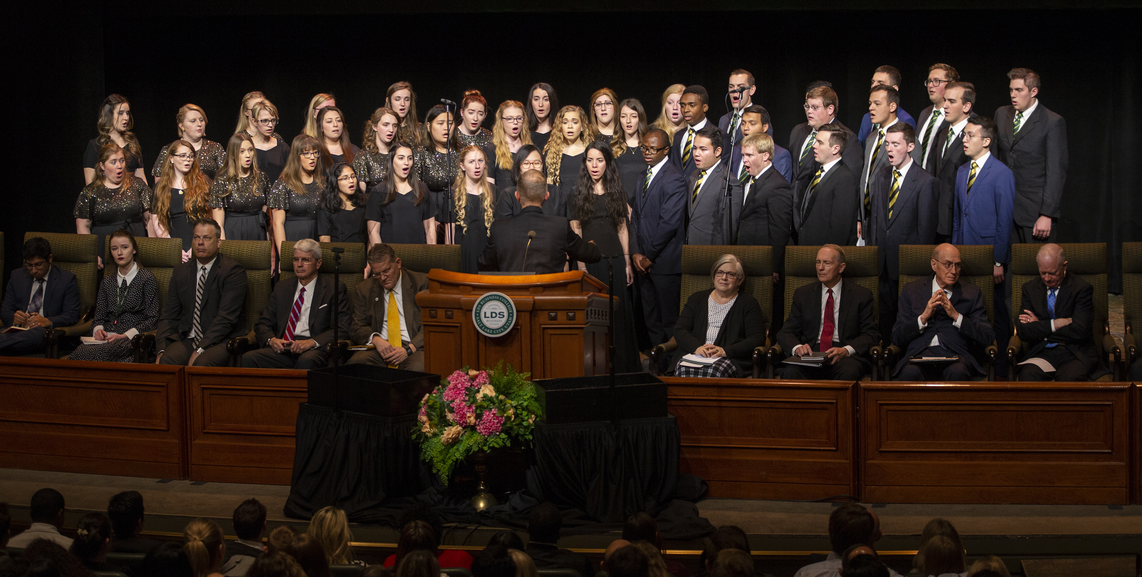 Choir members sing prior to President Henry B. Eyring speaking to LDS Business College students during a devotional in the Conference Center Theater in Salt Lake City on Tuesday, Nov. 6, 2018.