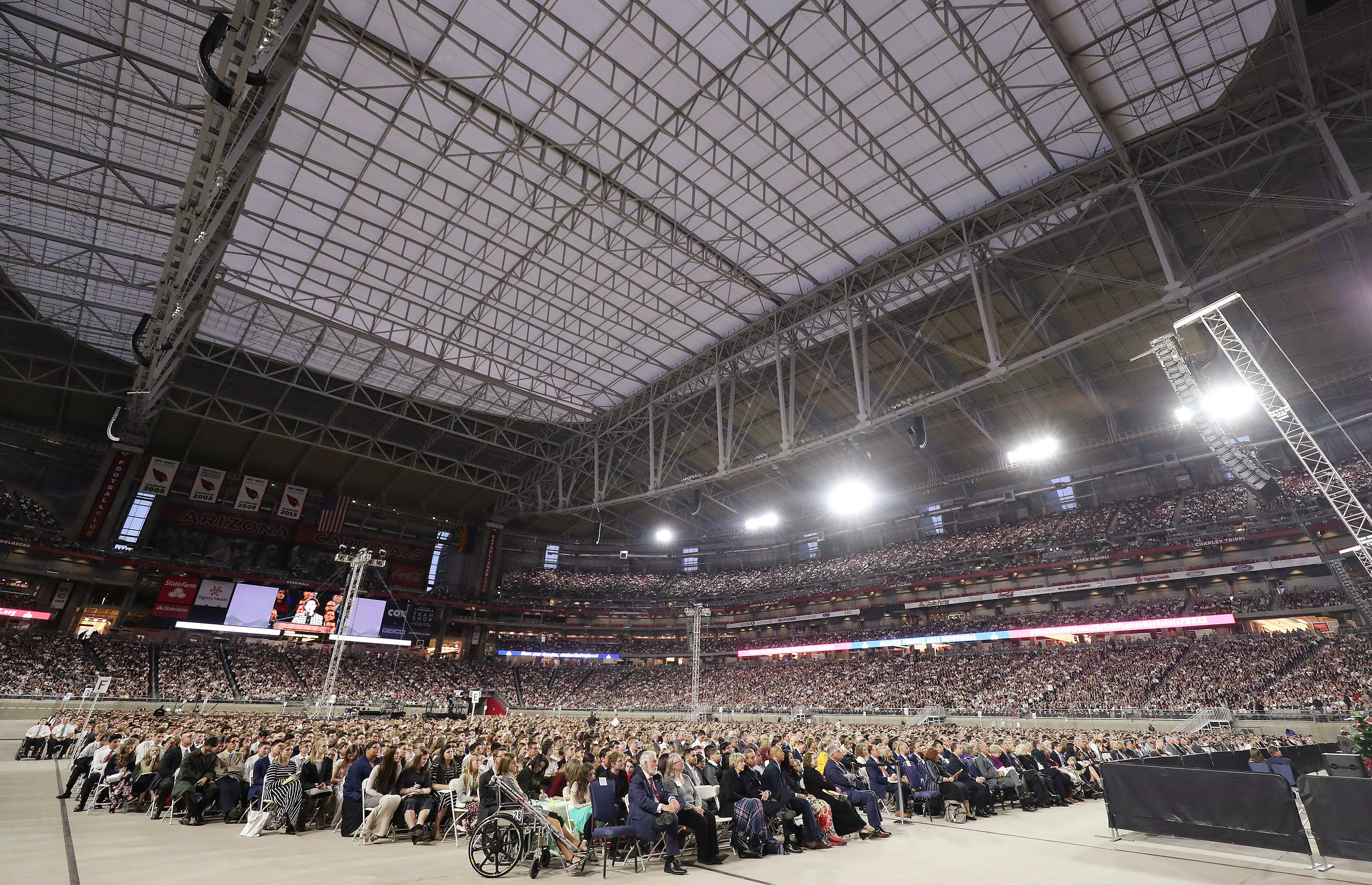 Attendees listen during a devotional at the State Farm Stadium in Phoenix on Sunday, Feb. 10, 2019.