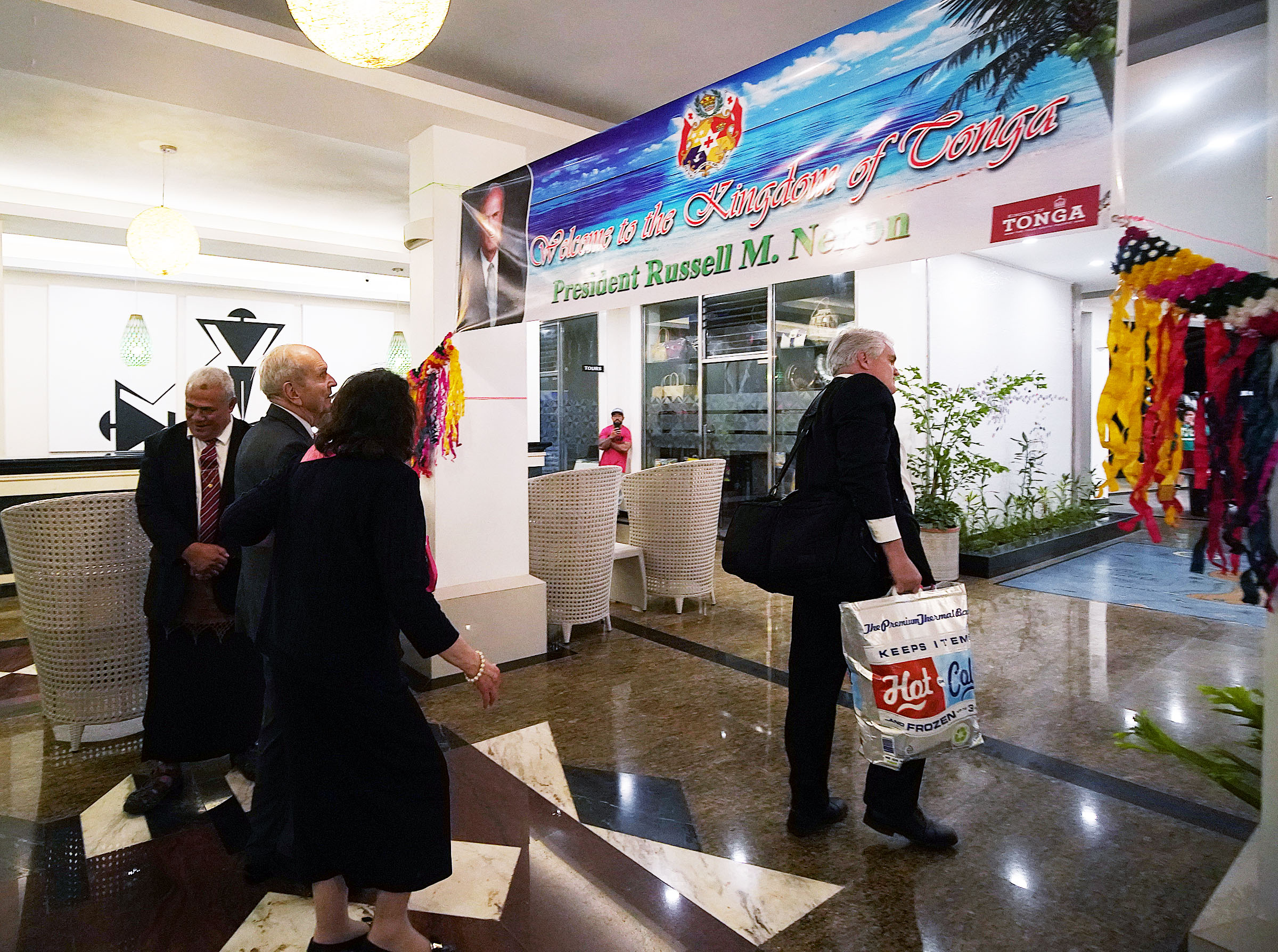 President Russell M. Nelson of The Church of Jesus Christ of Latter-day Saints, and his wife, Sister Wendy Nelson, look at a banner hung at the hotel welcoming them as they arrive in Nuku'alofa, Tonga, on Wednesday, May 22, 2019.