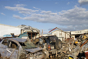 Piles of damaged cars and other rubble can be seen for miles and miles in northern Japan, where an earthquake and tsunami on March 11, 2011, left 20,000 people dead and destroyed more than 551,000 homes.