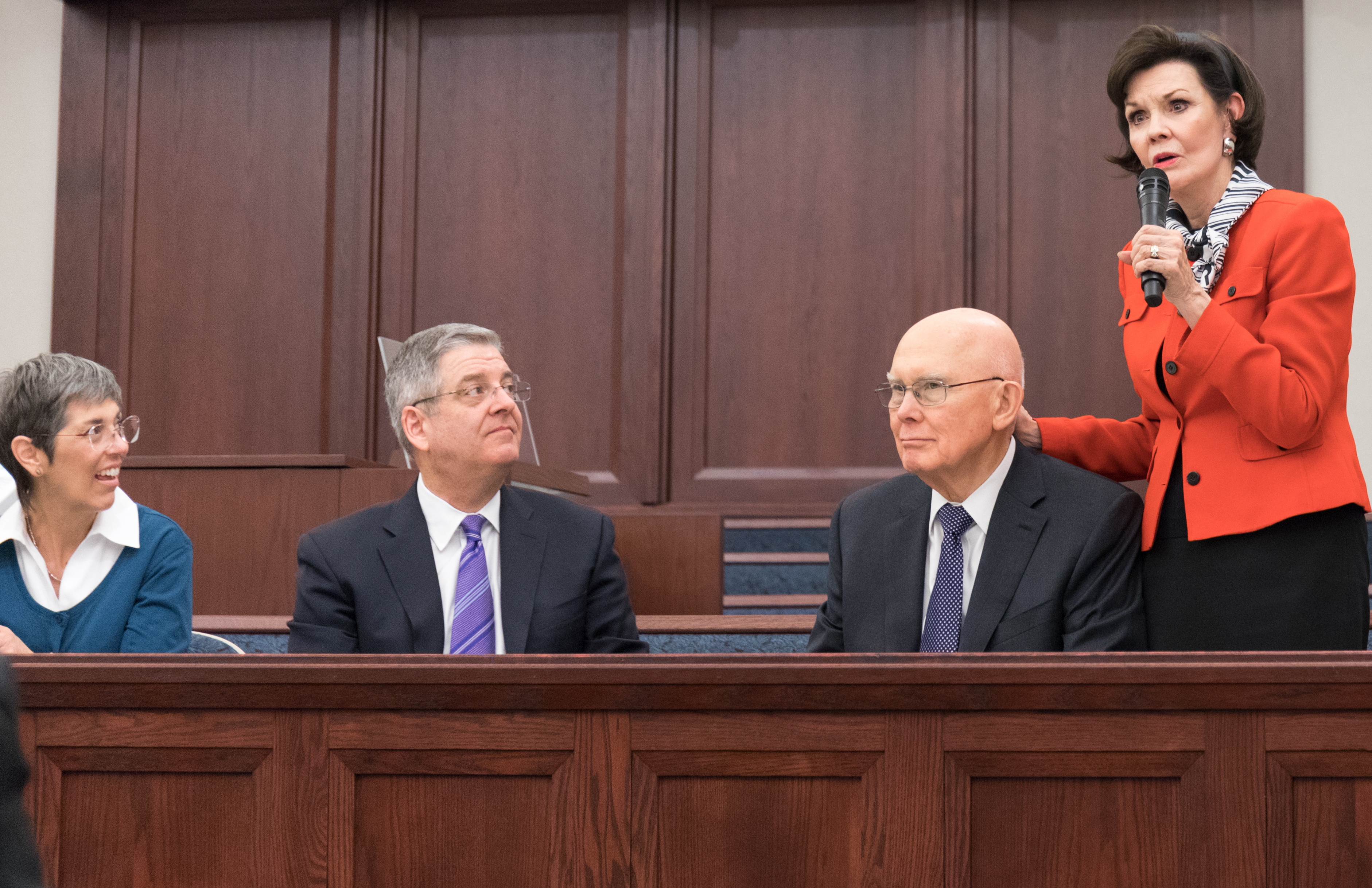 Sister Kristen Oaks shares insight during a Feb. 2, 2019, devotional for young married couples in downtown Chicago. Also pictured are Sister Auralee Scott, Elder K. David Scott and President Dallin H. Oaks.