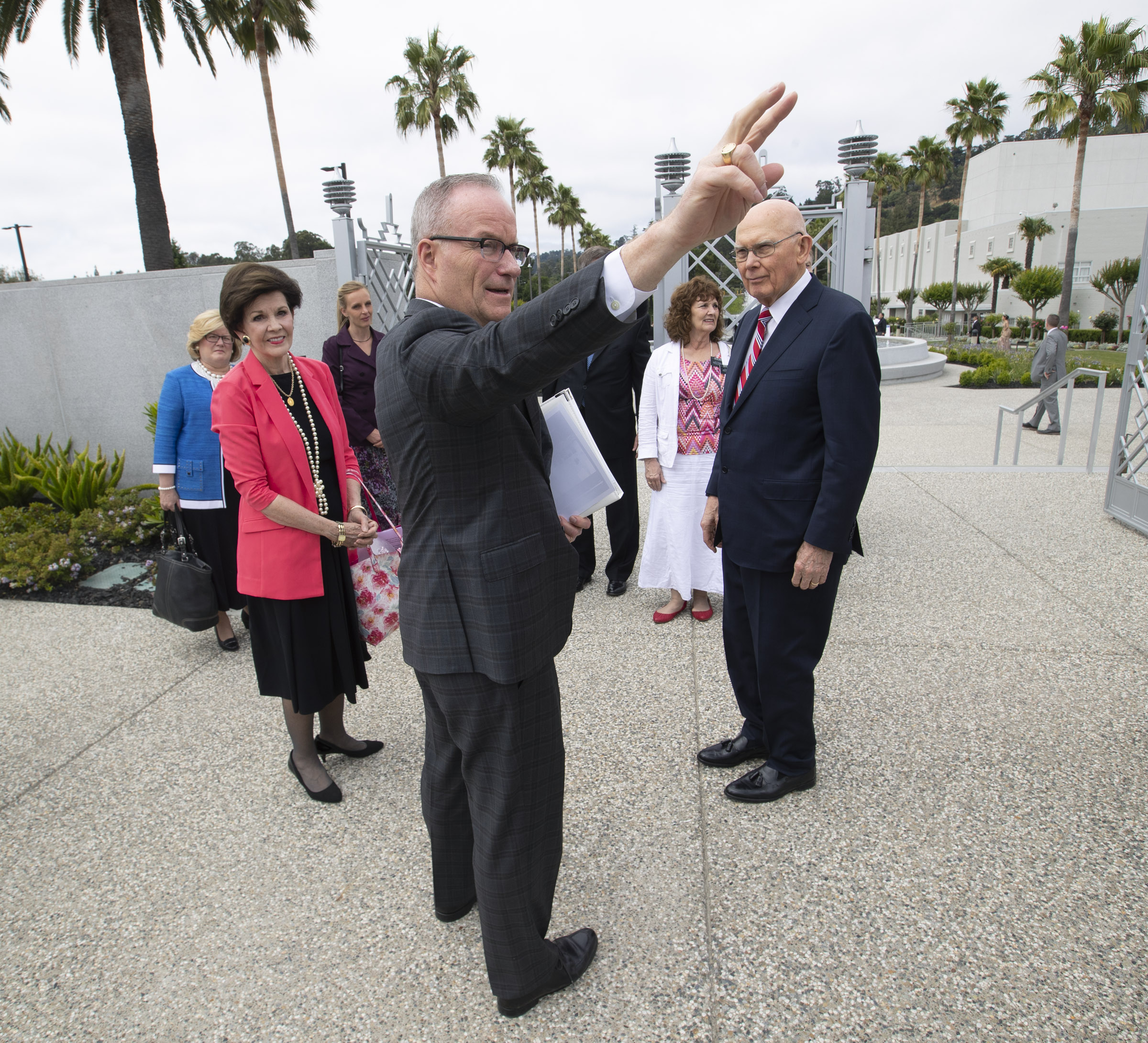 Thomas E. Coburn, managing director of the Temple Department, points out new areas of the Oakland California Temple as President Dallin H. Oaks, first counselor in the First Presidency, and his wife, Sister Kristen Oaks, arrive for a walk-through on Saturday, June 15, 2019.