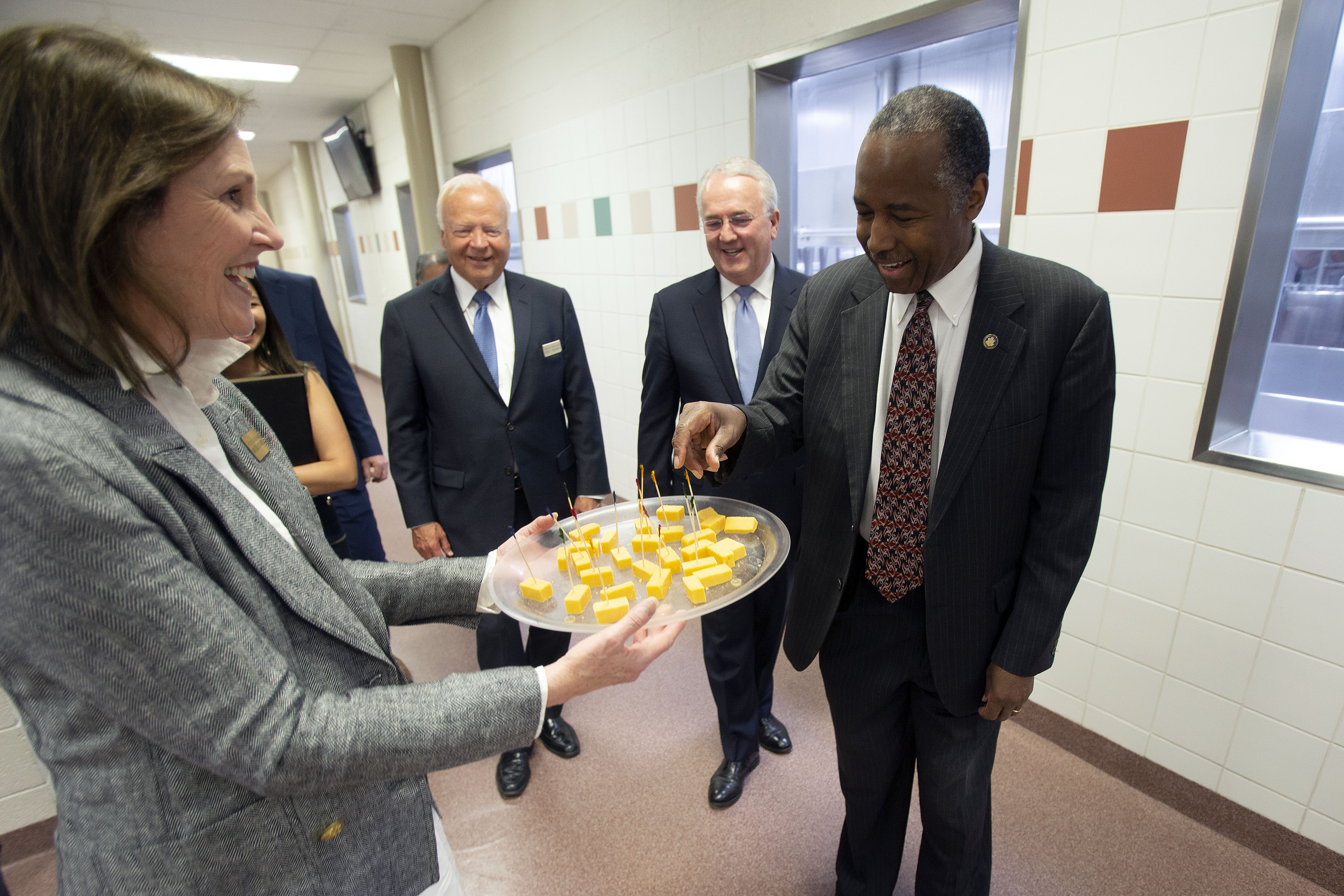Sister Marsha Richards, wife of Elder Kent F. Richards, offers a cheese sample to HUD secretary Dr. Ben Carson at the Welfare Squares dairy facility in Salt Lake City, Utah, July 11, 2019.
