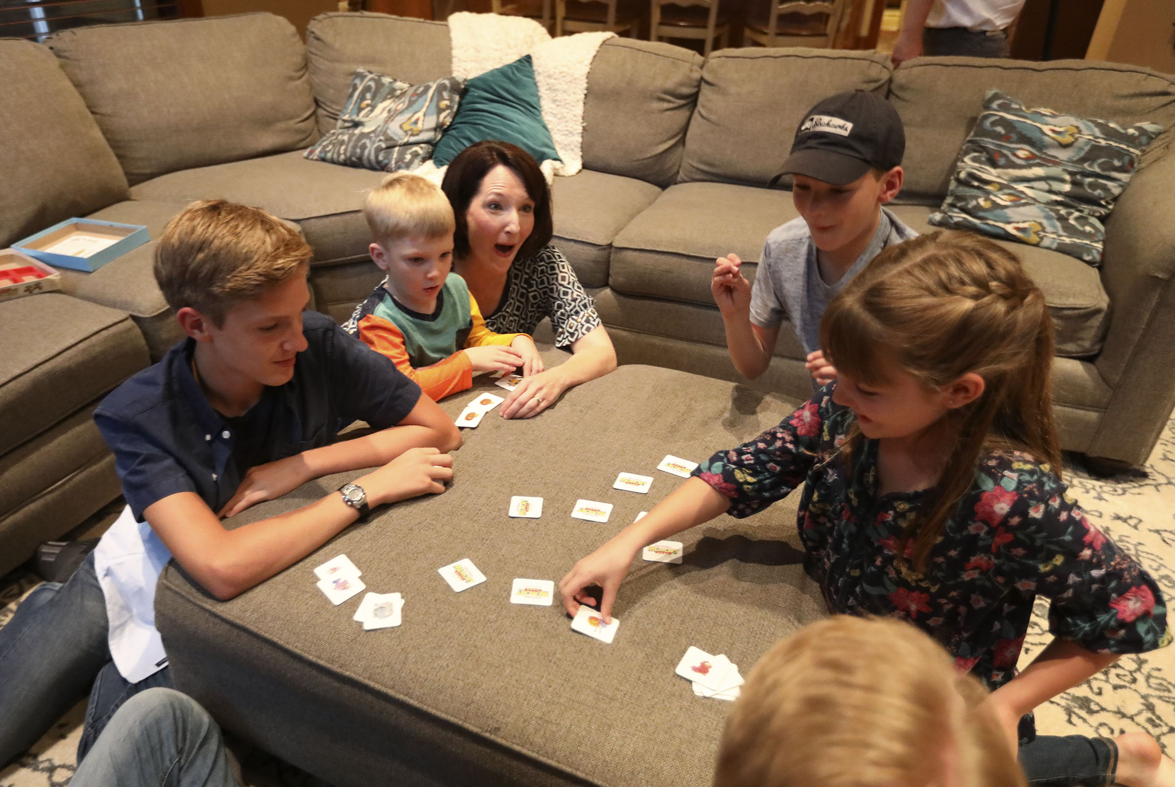 Ben, Daniel, Alexis, Tom and Emilia Allen play Memory at home in Renton, Wash., on Friday, Sept. 14, 2018.
