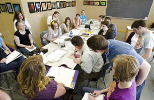 Wade Huntsman demonstrates to his students during an art class at BYU-Idaho. Although the enrollment numbers are up, the university has tried to keep class sizes small and each teacher's focus on students rather than research.