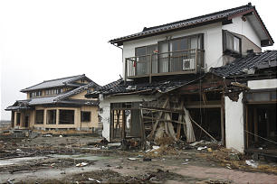 Remnant of houses in the greater Sendai area remain almost one year after a March 11,2011 earthquake and tsunami left 15,000 dead and 4,000 missing in Japan.