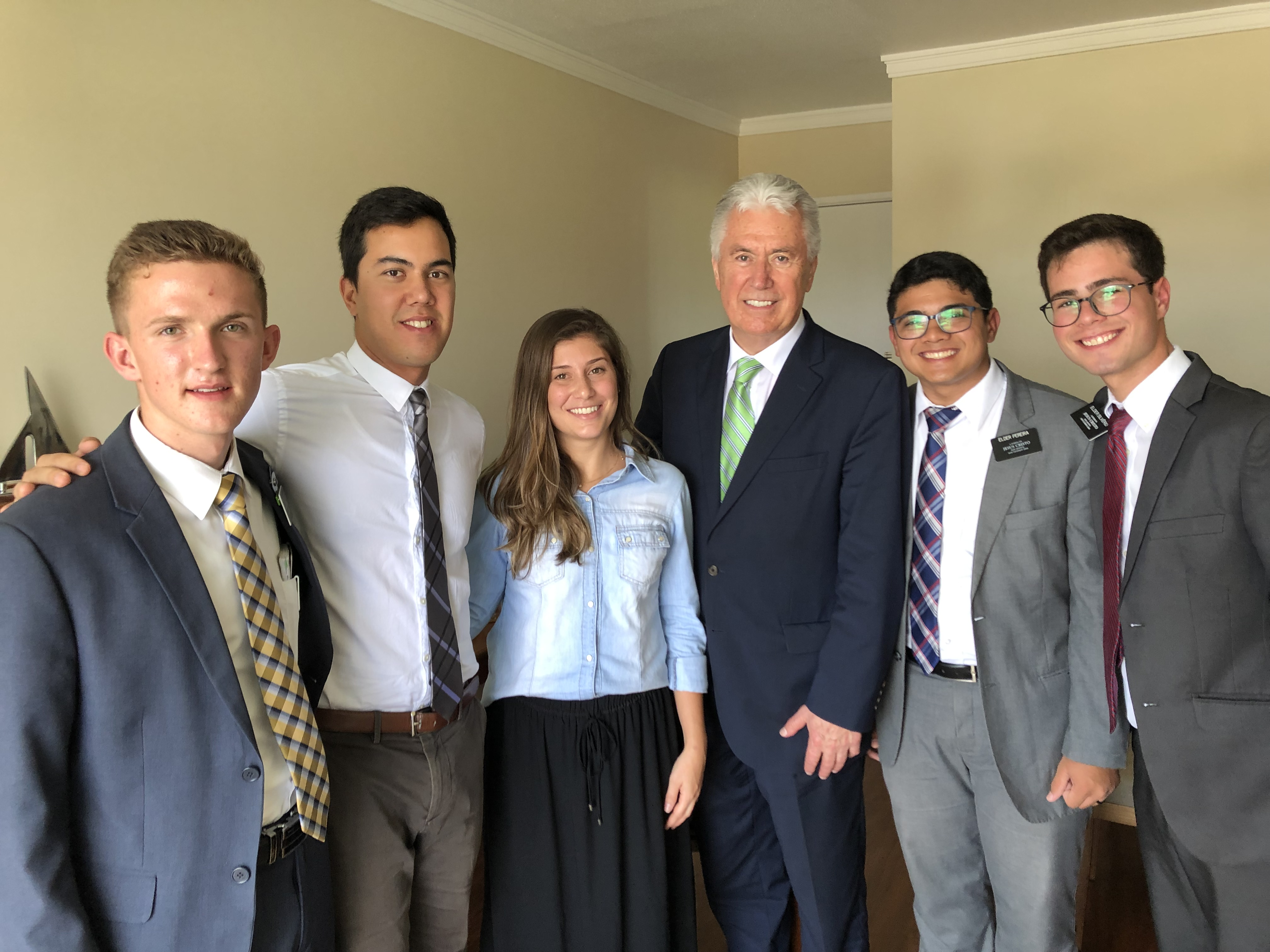 Elder Dieter F. Uchtdorf of the Quorum of the Twelve Apostles, pose for a photo with Zenon and Natalia Spaveevskas in their apartment after lesson with Elders Brennan Lance Stimpson, Gabriel Luiz Rodriguez Silvério and Leonário Lima Pereira of the Brazil São Paulo West Mission in February 2019.