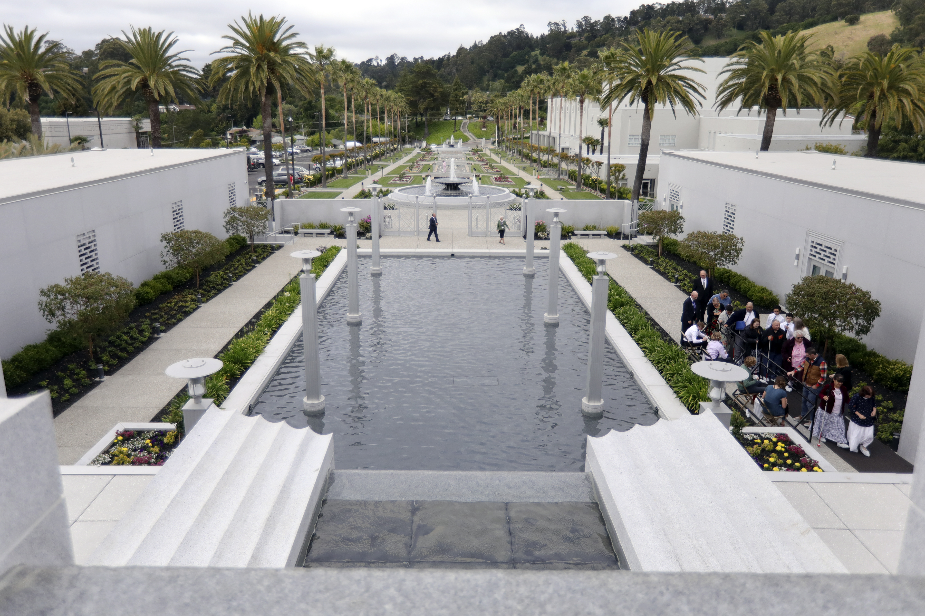 People approach the entrance to tour the newly renovated Oakland California Temple of The Church of Jesus Christ of Latter-day Saints in Oakland, Cali., on Monday, May 6, 2019.