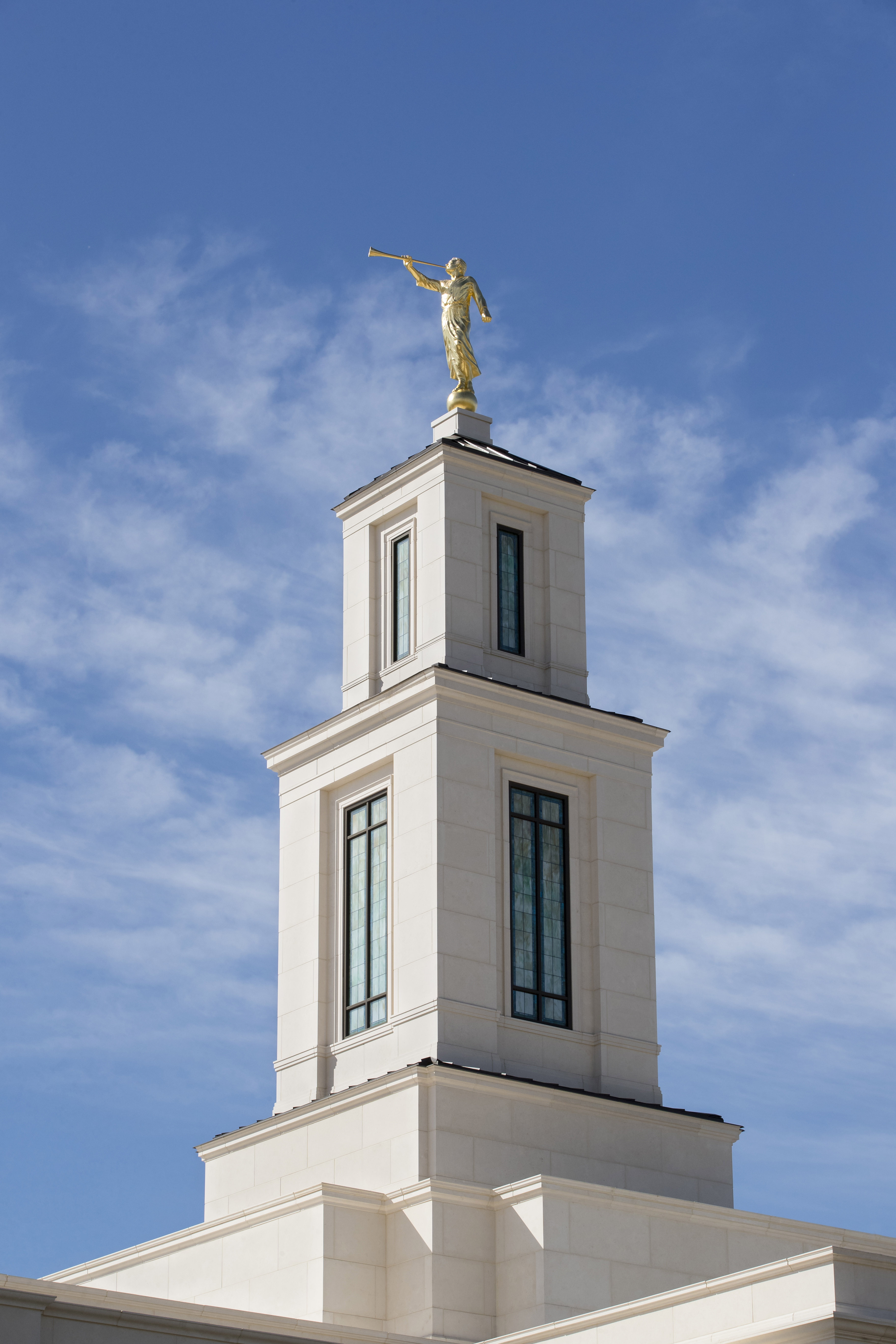 A gold-leafed statue representative of the ancient Book of Mormon prophet Moroni stands atop the Oklahoma City Oklahoma Temple.