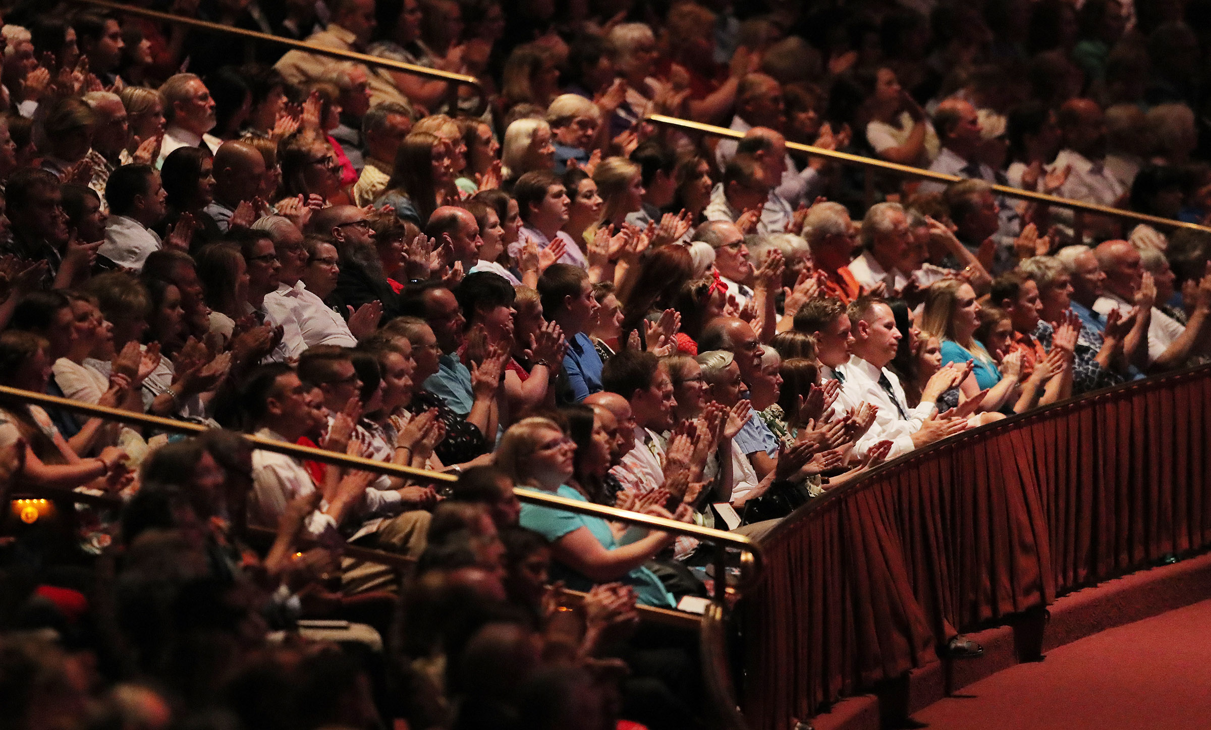 Audience members applaud the Mormon Tabernacle Choir and Orchestra at Temple Square during their annual Pioneer Concert at the Conference Center in Salt Lake City on Friday, July 20, 2018.