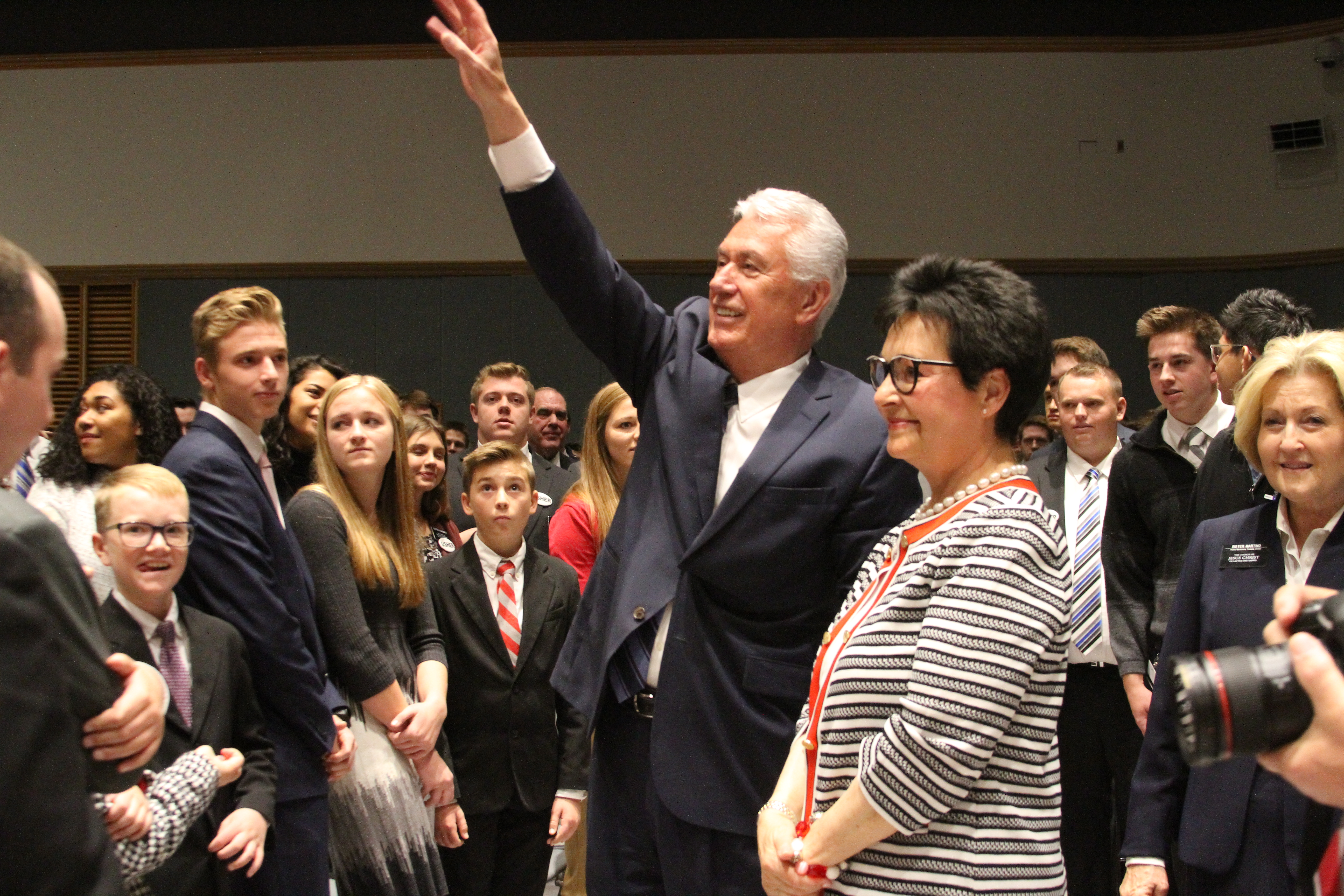 Elder Dieter F. Uchtdorf of the Quorum of the Twelve Apostles, with his wife, Sister Harriet Uchtdorf, waves to missionaries following a Thanksgiving morning devotional in the Provo MTC on Nov. 22, 2018.