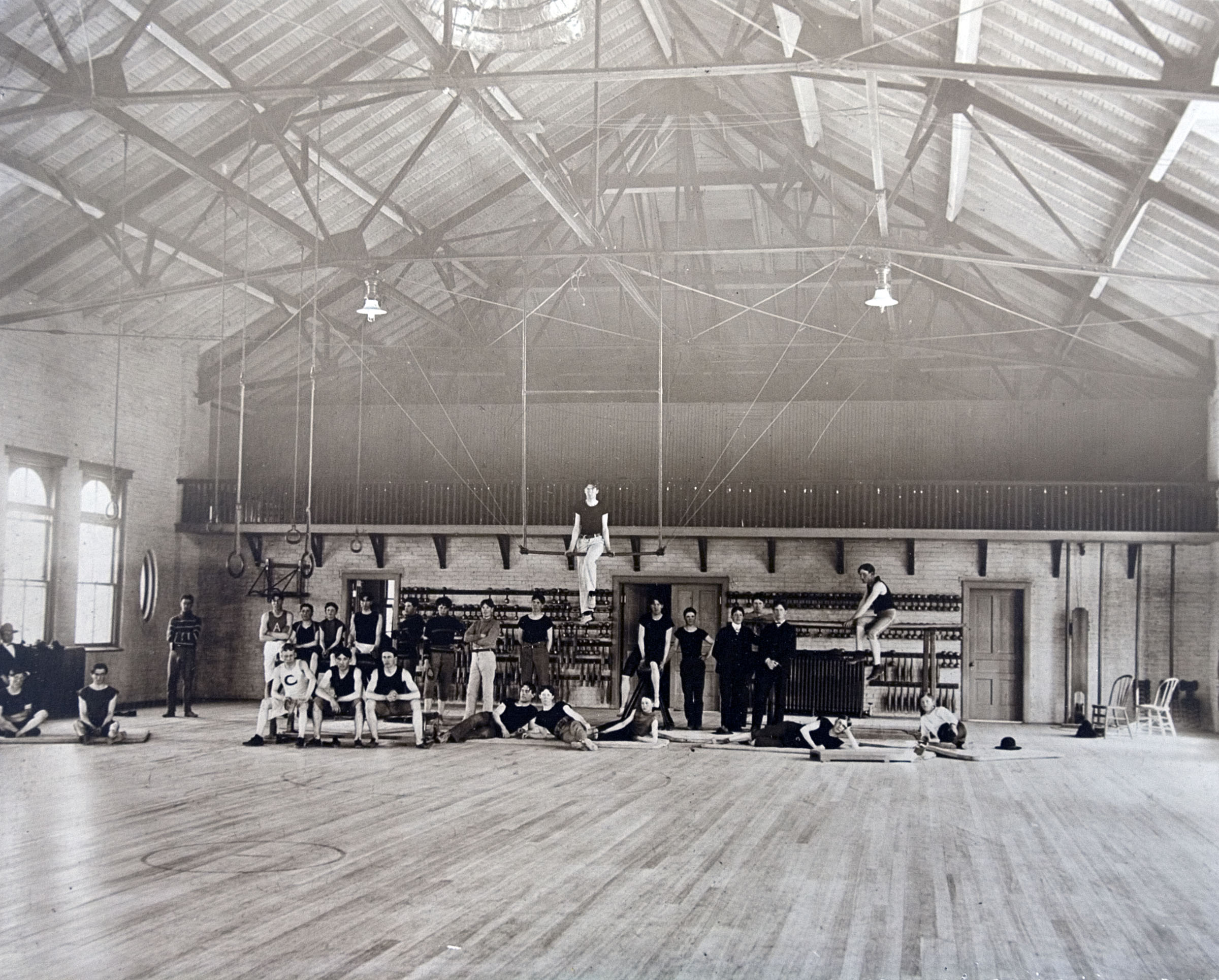"""""""When the Language Training Mission was faced with overcrowded conditions, missionaries were required to live in the Men's Gym. Elders who stayed in the gym called it the 'Provo Hilton.' """" — This is the caption information found on the frame plaque accompany this photo, one nearly dozen historical photos showing the development of the Language Training Mission and Missionary Training Center facilities in Provo since the 1960s."""