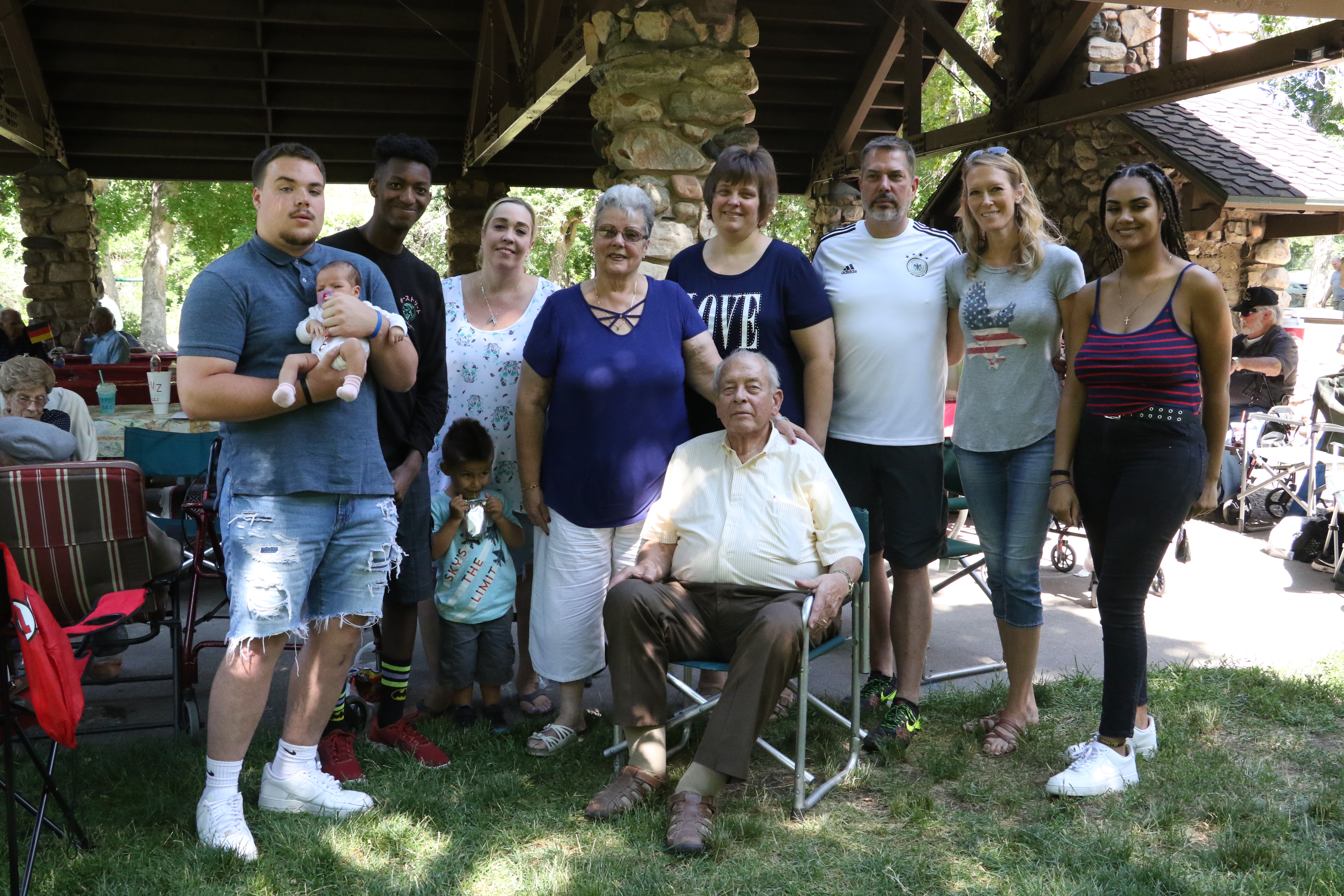 Bishop Volker Diethelm Hagen, seated, and his wife, Sister Gisa Hagen, immediately left, pose with their family members who attended the annual ward picnic at Washington Terrace Park on July 13, 2019.