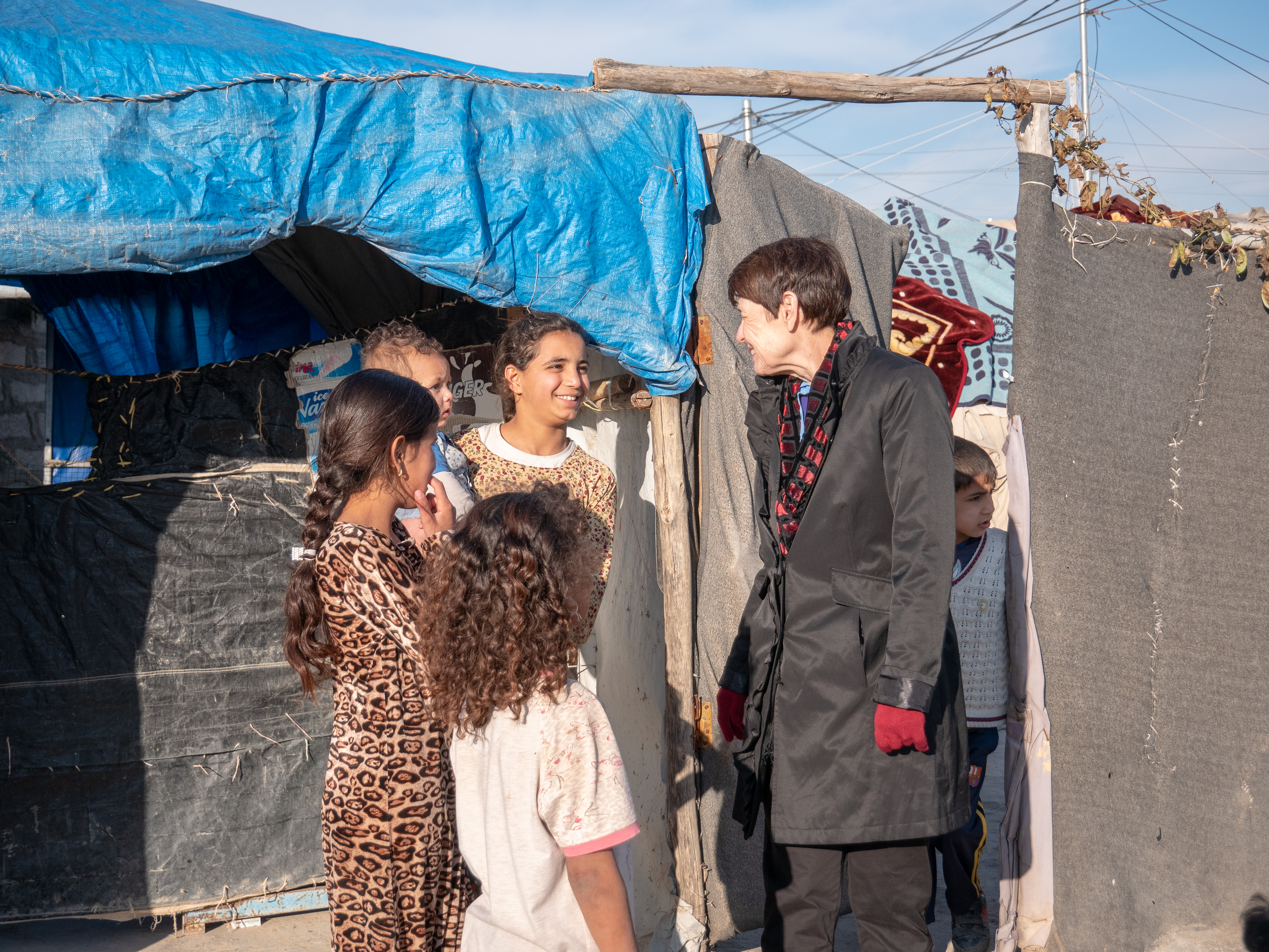 Sister Susan Bednar, right, visits with youth at the Ashti refugee camp near Erbil, Kurdistan, on Jan. 21, 2019. LDS Charities assisted in 750 tents in two refugee camps in the area.