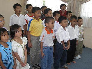 Bintulu 3rd Branch Primary children sing. the Primary of 34 children is led by two teenage girls -- one the president, the other the music leader. The children sing with their whole heart. They love singing.
