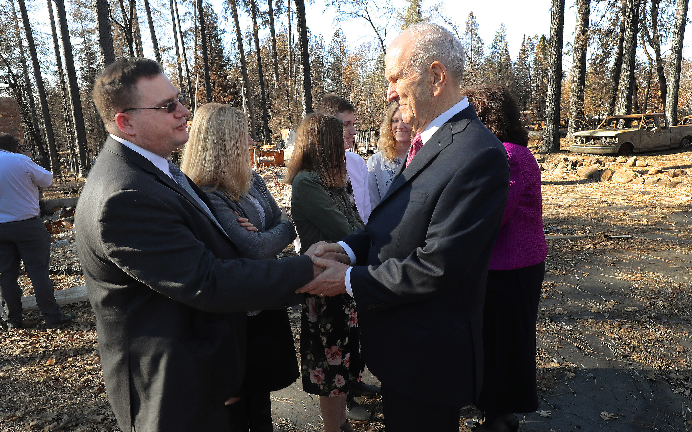 "President Russell M. Nelson of The Church of Jesus Christ of Latter-day Saints talks to fire victim Robert Harrison and his family in Paradise, California on Sunday, Jan. 13, two months after the Camp Fire destroyed 1,400 homes and hundreds of businesses. President Nelson wrote about the visit in an op-ed published Feb. 10 in The Arizona Republic. Life with God is far better than one without him, he wrote in the op-ed, titled ""Healing Hearts."""