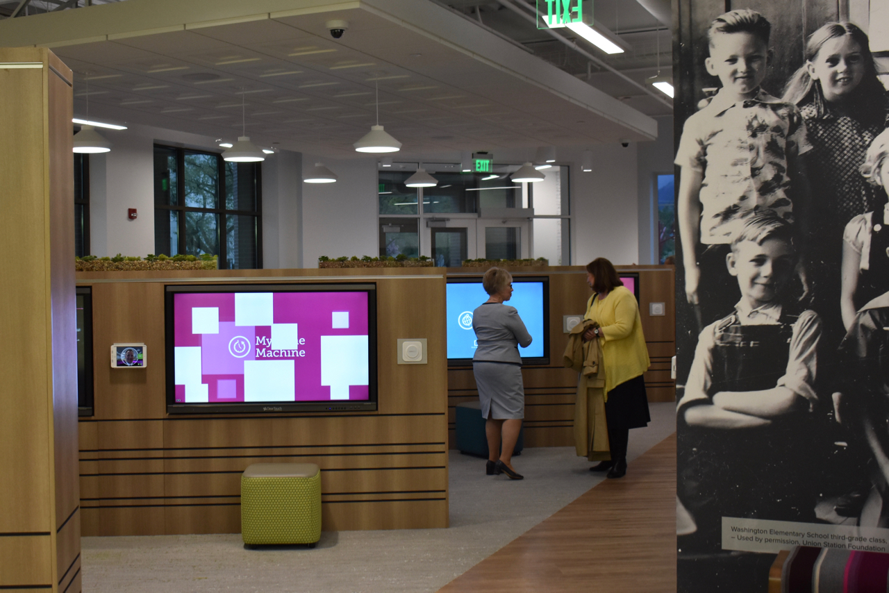 Visitors to the April 30, 2019, dedication services of the new Ogden Utah FamilySearch Center walk throught the interactive media on the main floor.