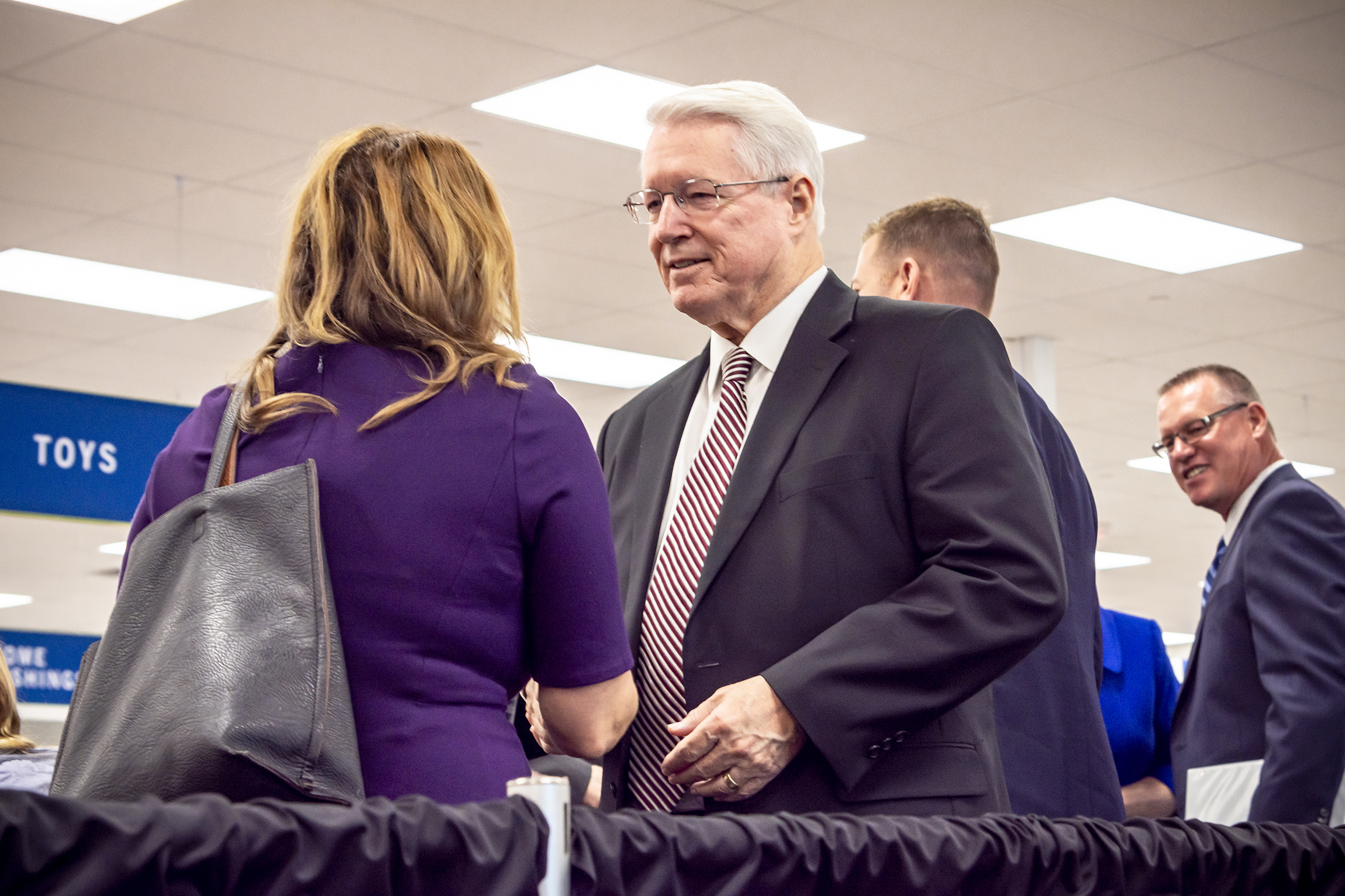 Bishop Dean M. Davies of the Presiding Bishopric of The Church of Jesus Christ of Latter-day Saints greets attendees of the dedication of a new Deseret Industries in Gilbert, Arizona, Oct. 20, 2018.